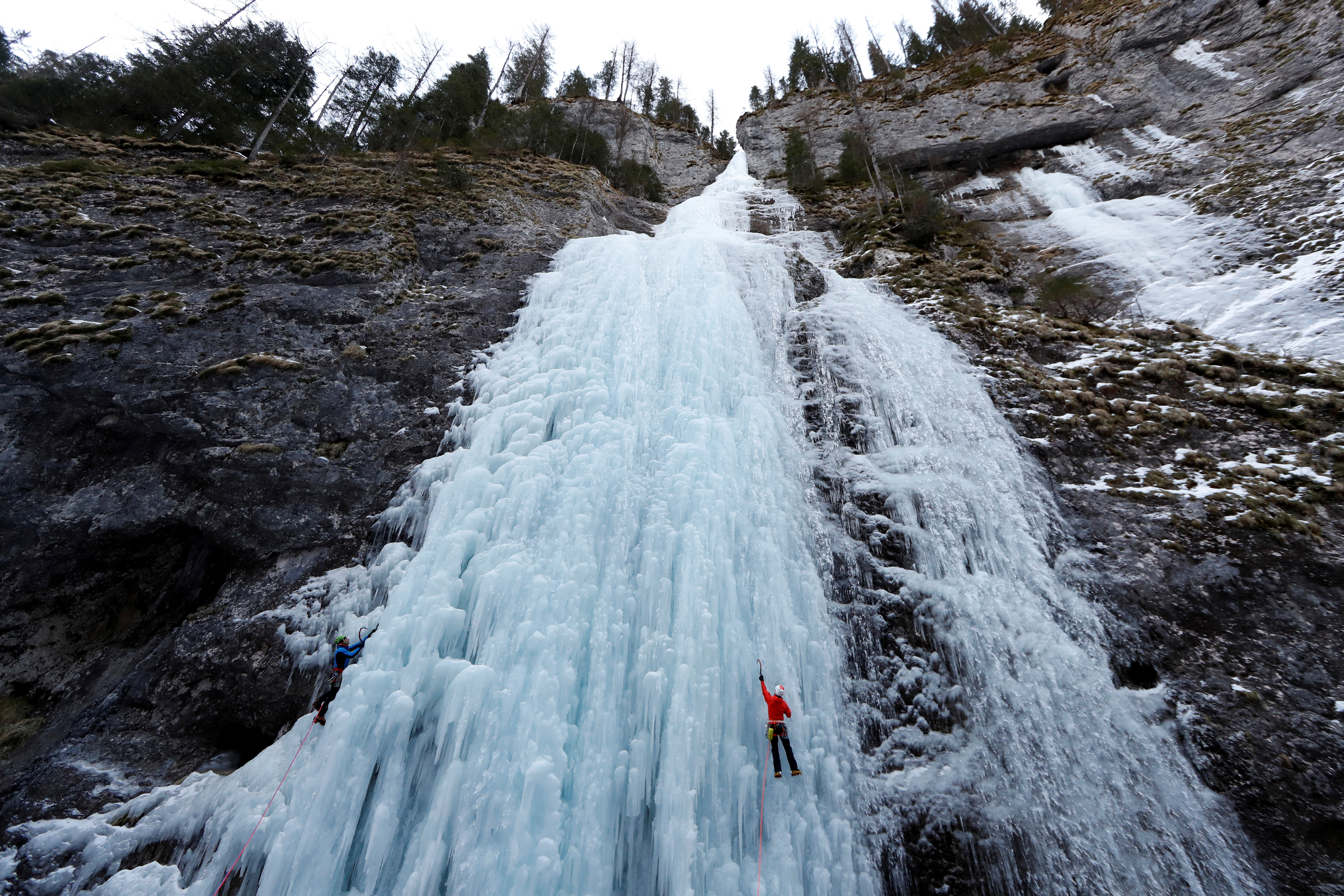 Italian alpine rescuers climb a frozen waterfall in Malga Ciapela, Italy, February 11, 2020. Picture taken  February 11, 2020. Twice a month throughout the year members of the Italian Alpine Rescue Service (CNSAS), many of whom are volunteers, gather for avalanche training 2,000 metres up mountains in the Dolomites. The Italian Alps are heavily affected by climate change with a constant temperature increase and more extreme weather fronts, resulting in shrinking glaciers and the risk of avalanches becoming more common. REUTERS/Yara Nardi