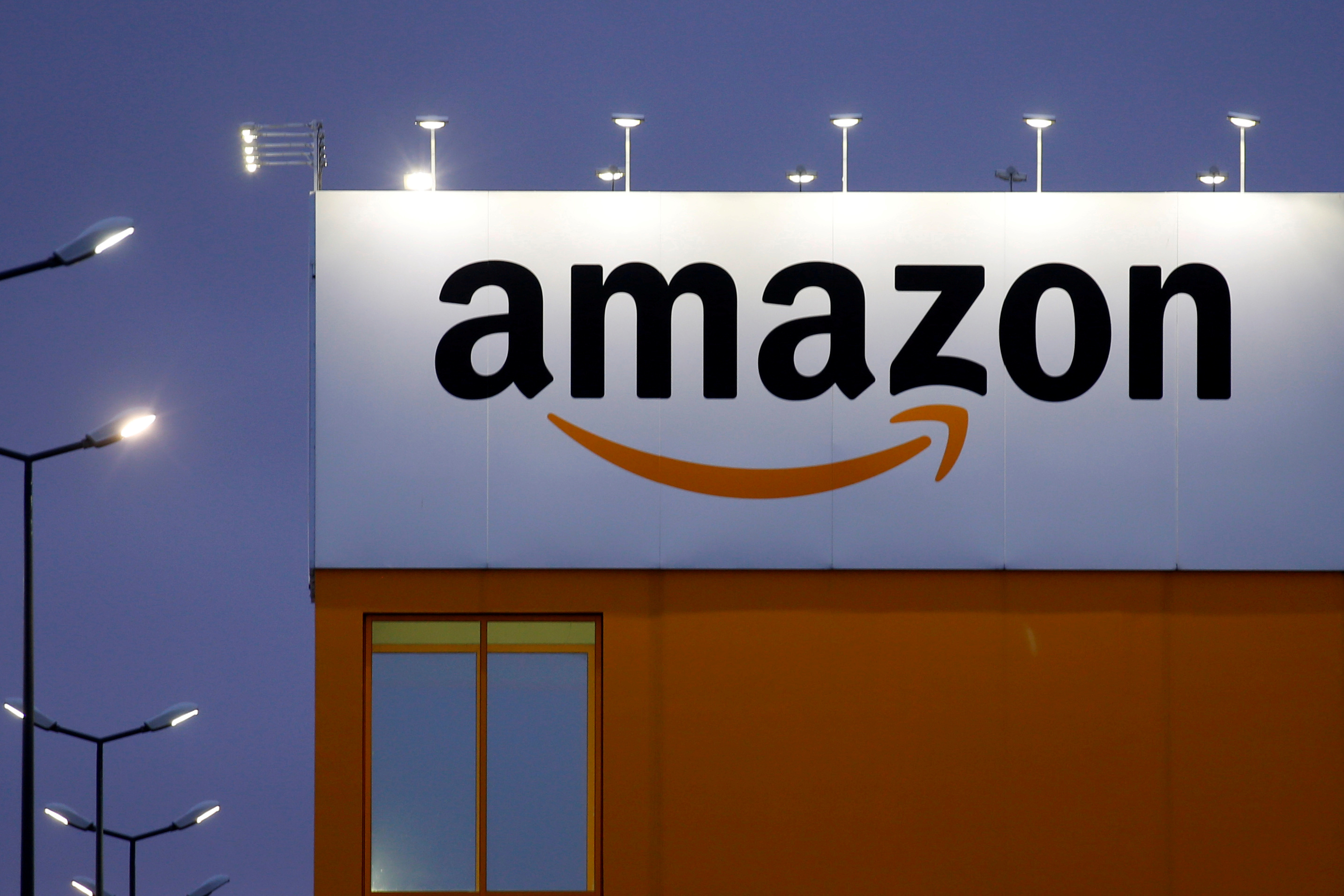 The logo of Amazon is seen at the company logistics center in Lauwin-Planque, northern France. REUTERS/Pascal Rossignol