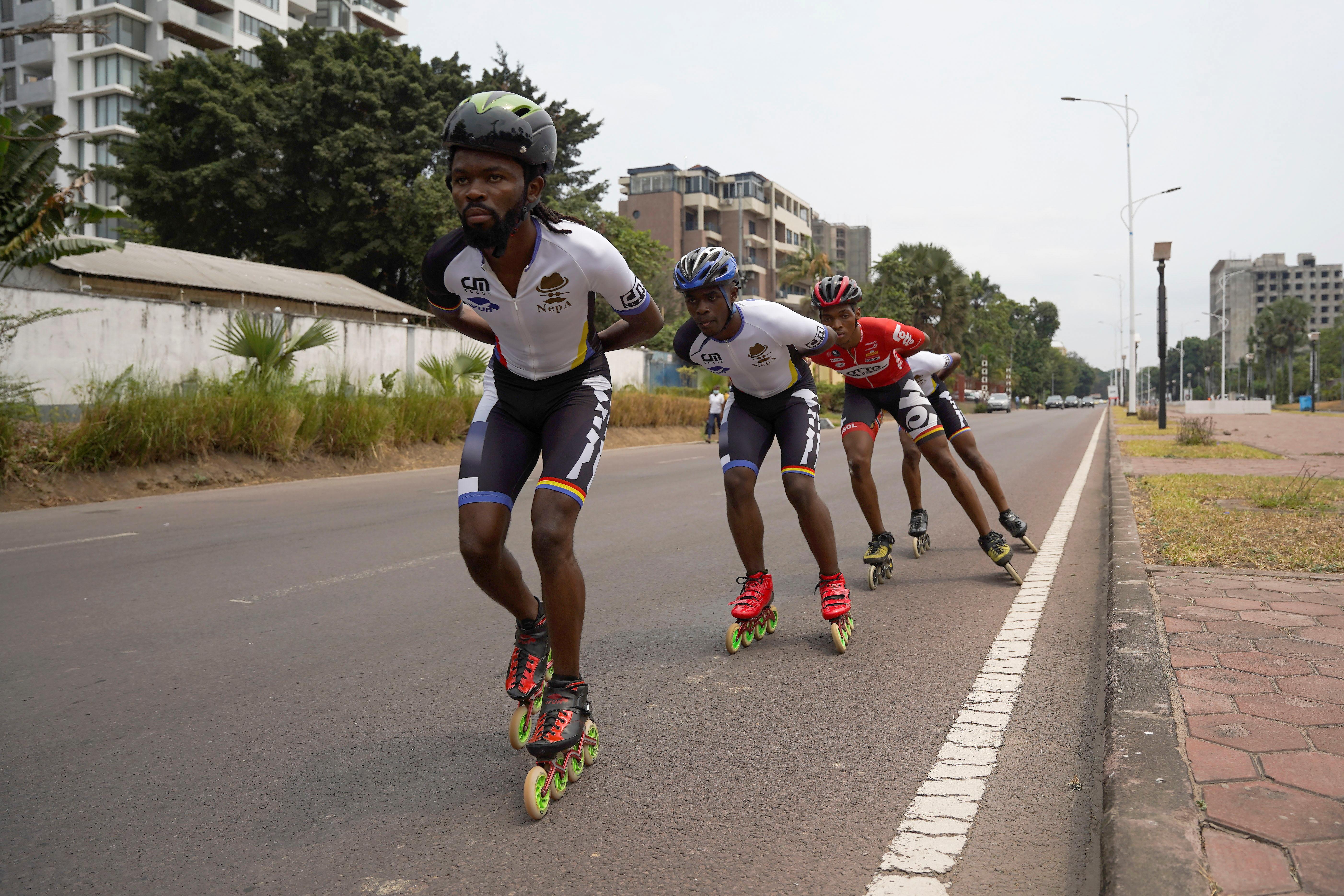 Serge Makolo leads his speed skating teammates during a training in Kinshasa, Democratic Republic of Congo, September 16, 2021. REUTERS/Hereward Holland