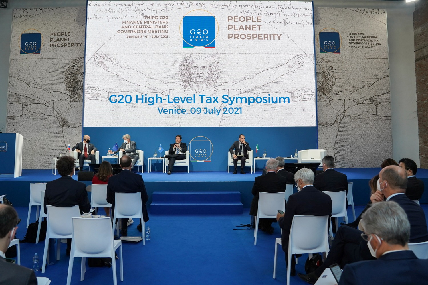 FILE PHOTO: Participants attend the G20 high-level tax symposium during the G20 finance ministers and central bank governors' meeting in Venice, Italy, July 9, 2021. G20 Italy/Handout via REUTERS