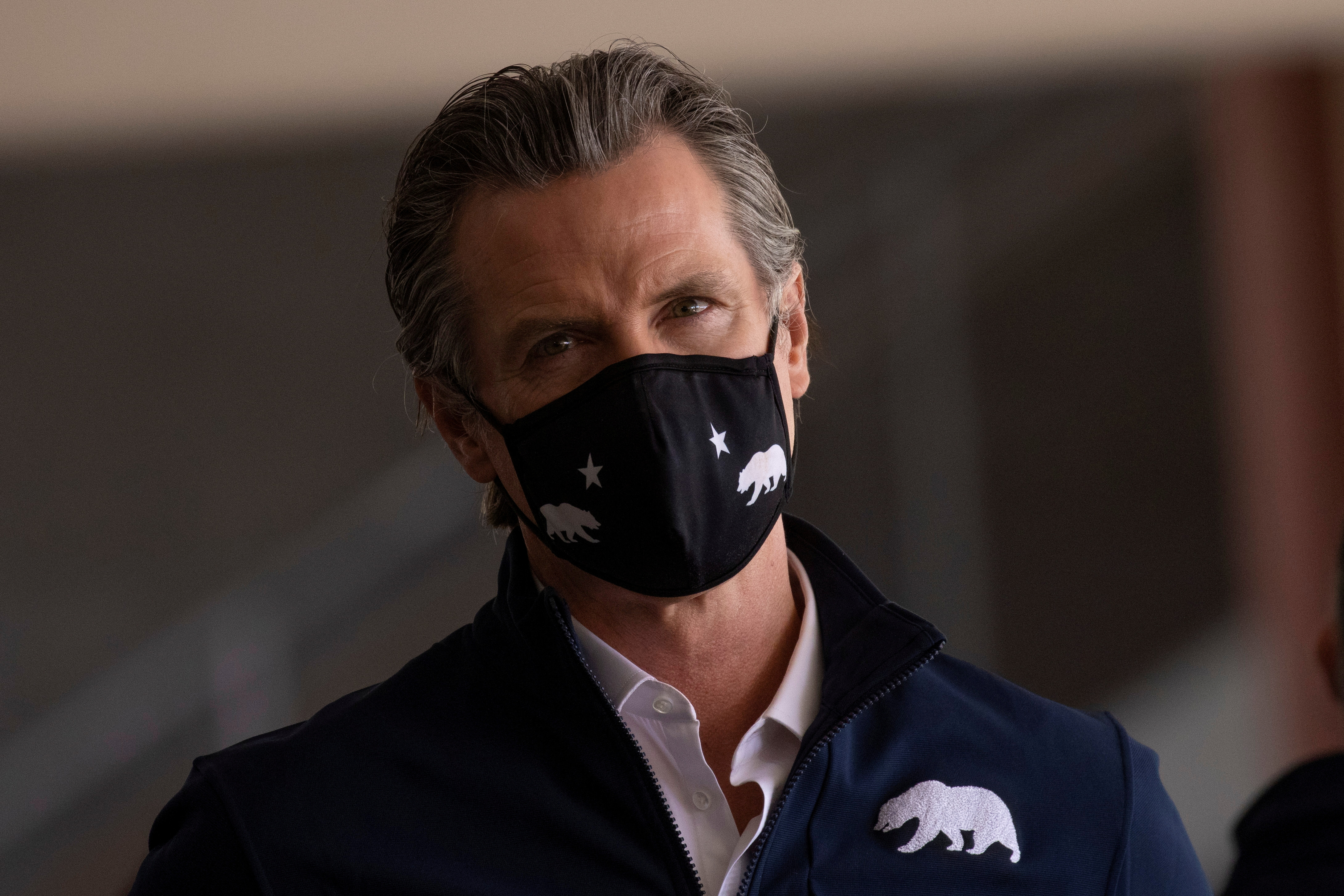 California Governor Gavin Newsom attends the opening of the country's first federal and state operated community vaccination site during the outbreak of the coronavirus disease (COVID-19) in Los Angeles, California, U.S., February 16, 2021.       REUTERS/Mike Blake
