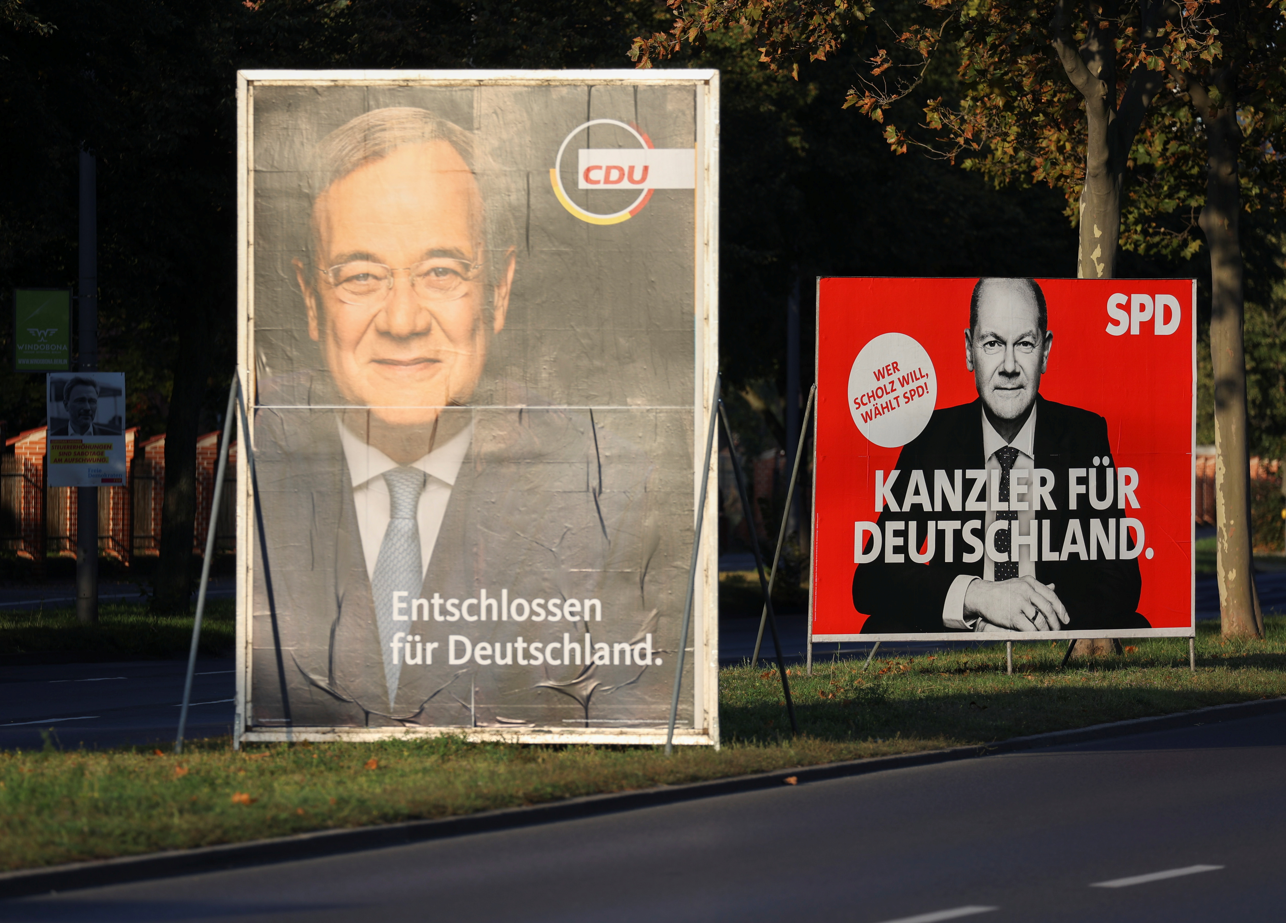 Election posters of Germany's top candidates for chancellor, North Rhine-Westphalia's State Premier and Christian Democratic Union (CDU) leader Armin Laschet and Olaf Scholz, German Minister of Finance of the Social Democratic Party (SPD) are pictured in Berlin, Germany, September 14, 2021. REUTERS/Christian Mang