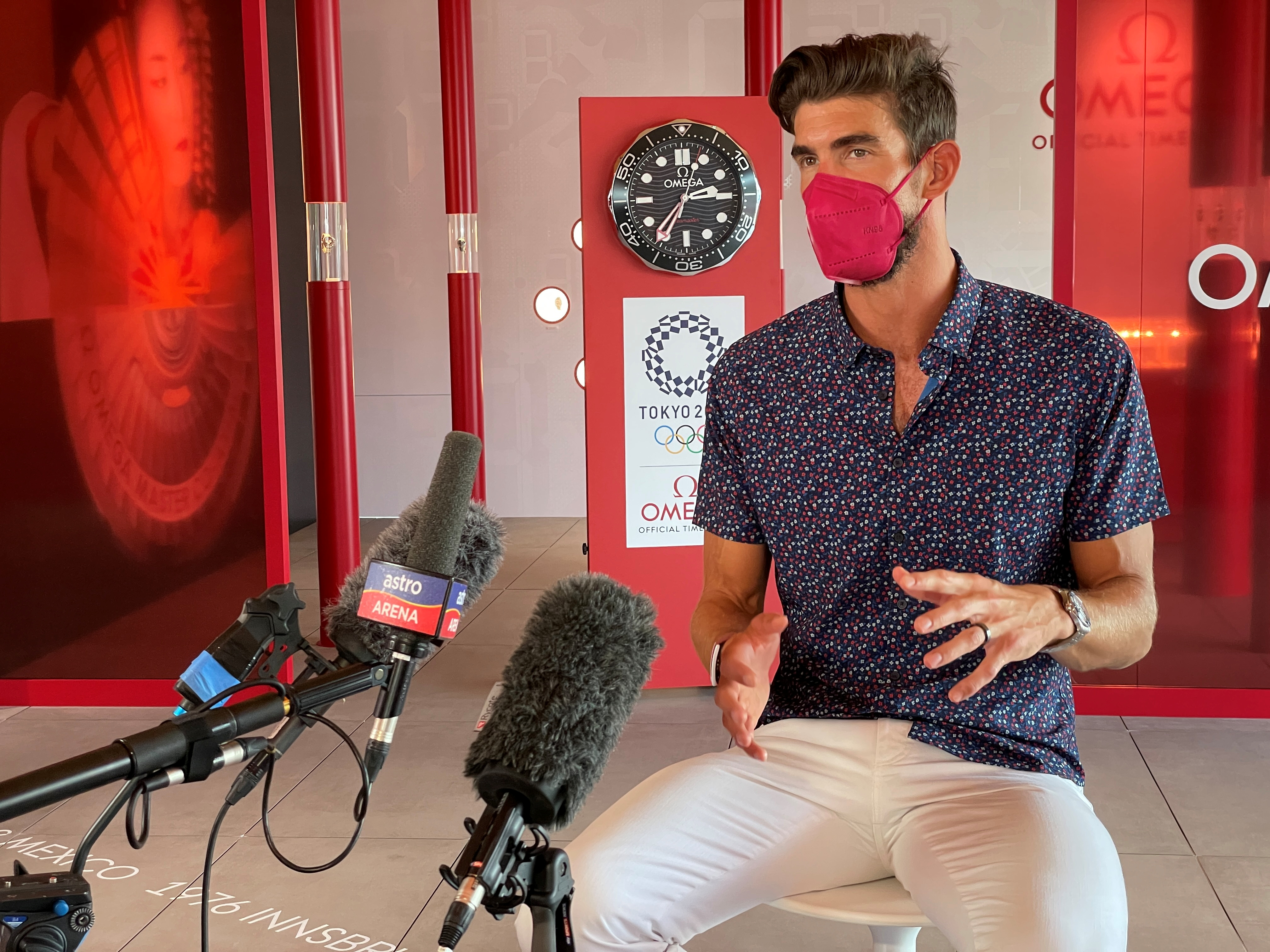 U.S. Olympic gold medalist Michael Phelps speaks during an interview with journalists on the sidelines of the Olympic Games in Tokyo, Japan July 25, 2021. REUTERS/Nathan Frandino
