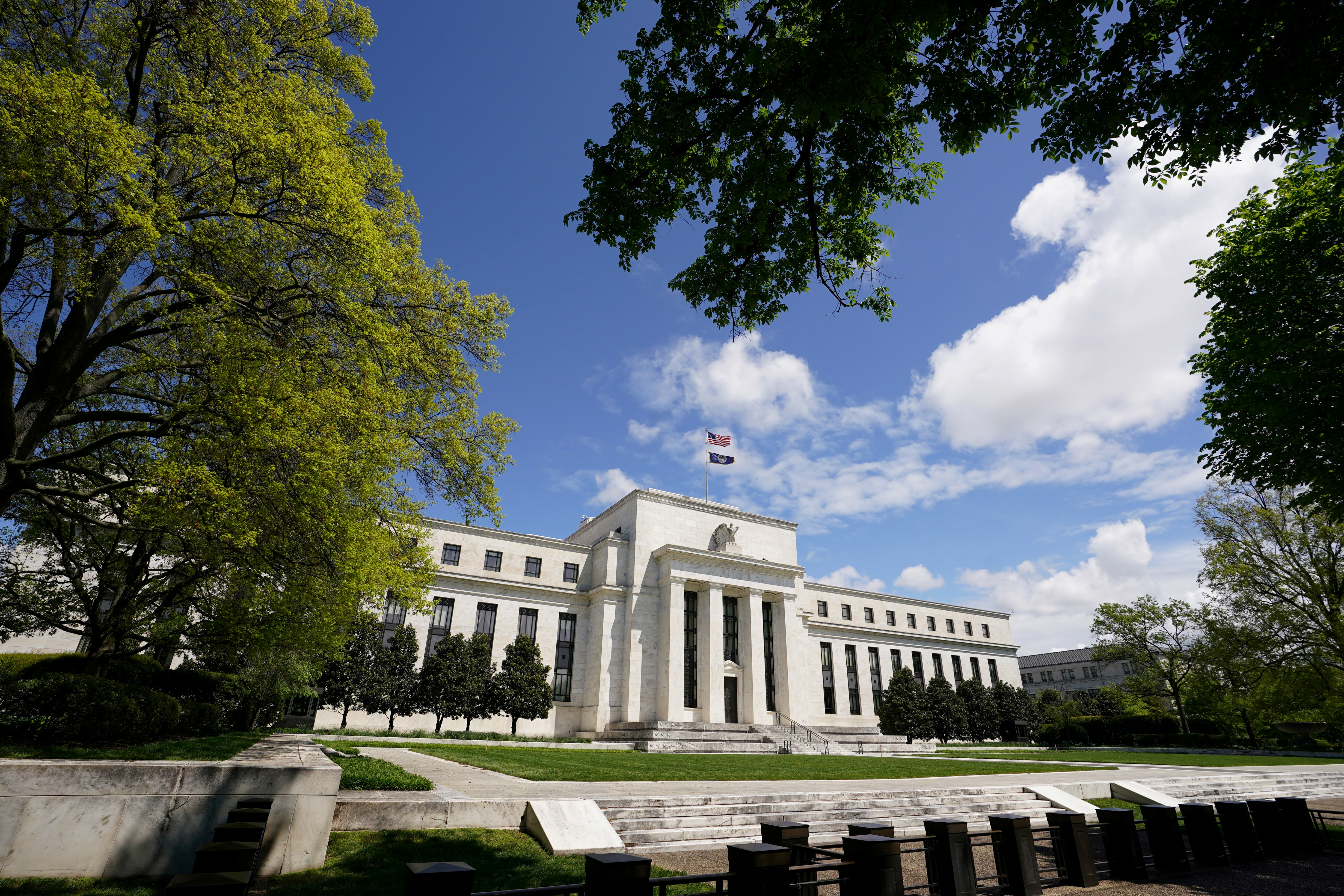 The Federal Reserve building is set against a blue sky in Washington, U.S., May 1, 2020. REUTERS/Kevin Lamarque