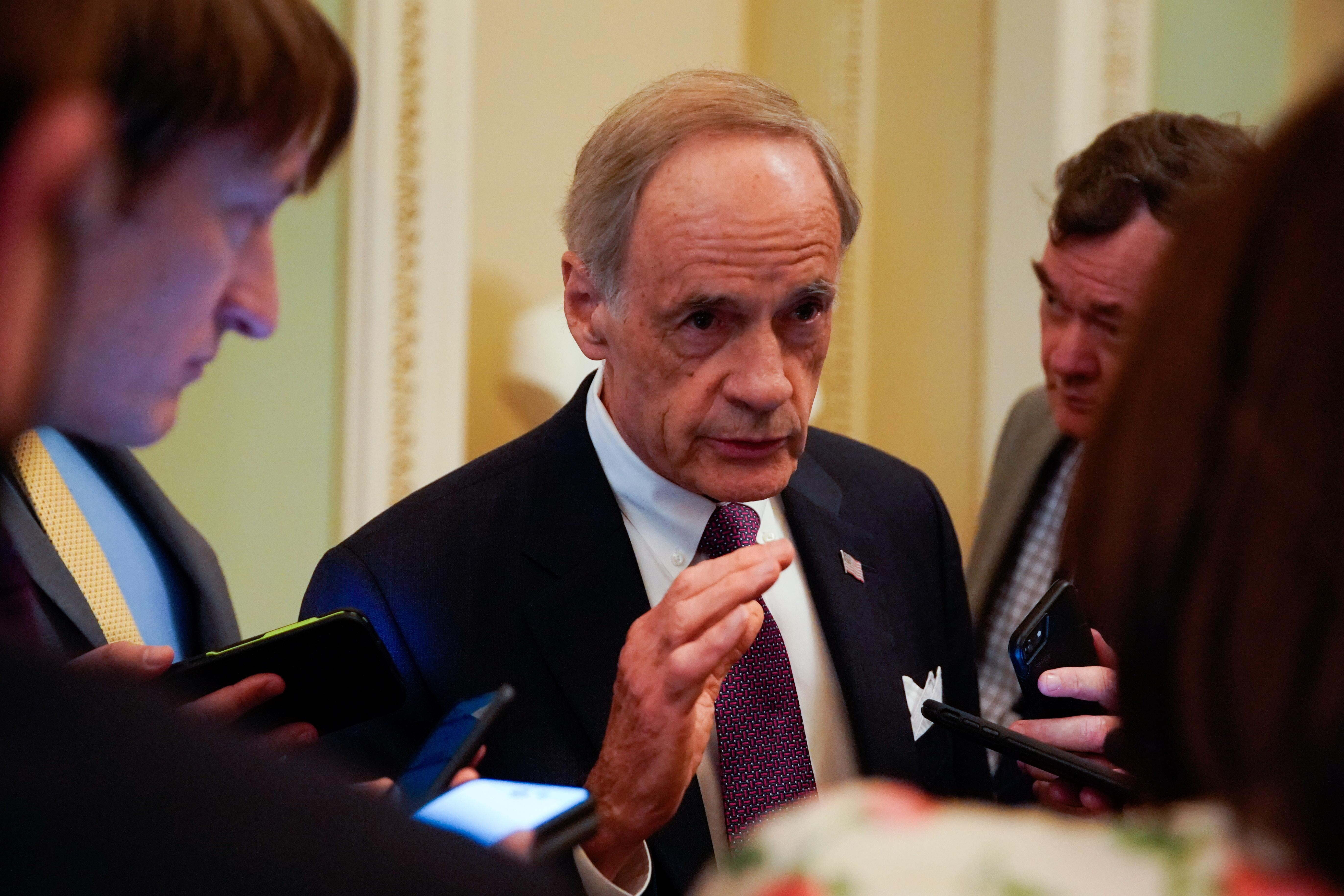 U.S. Senator Tom Carper (D-DE) speaks with reporters at the U.S. Capitol in Washington, U.S., July 22, 2021. REUTERS/Elizabeth Frantz