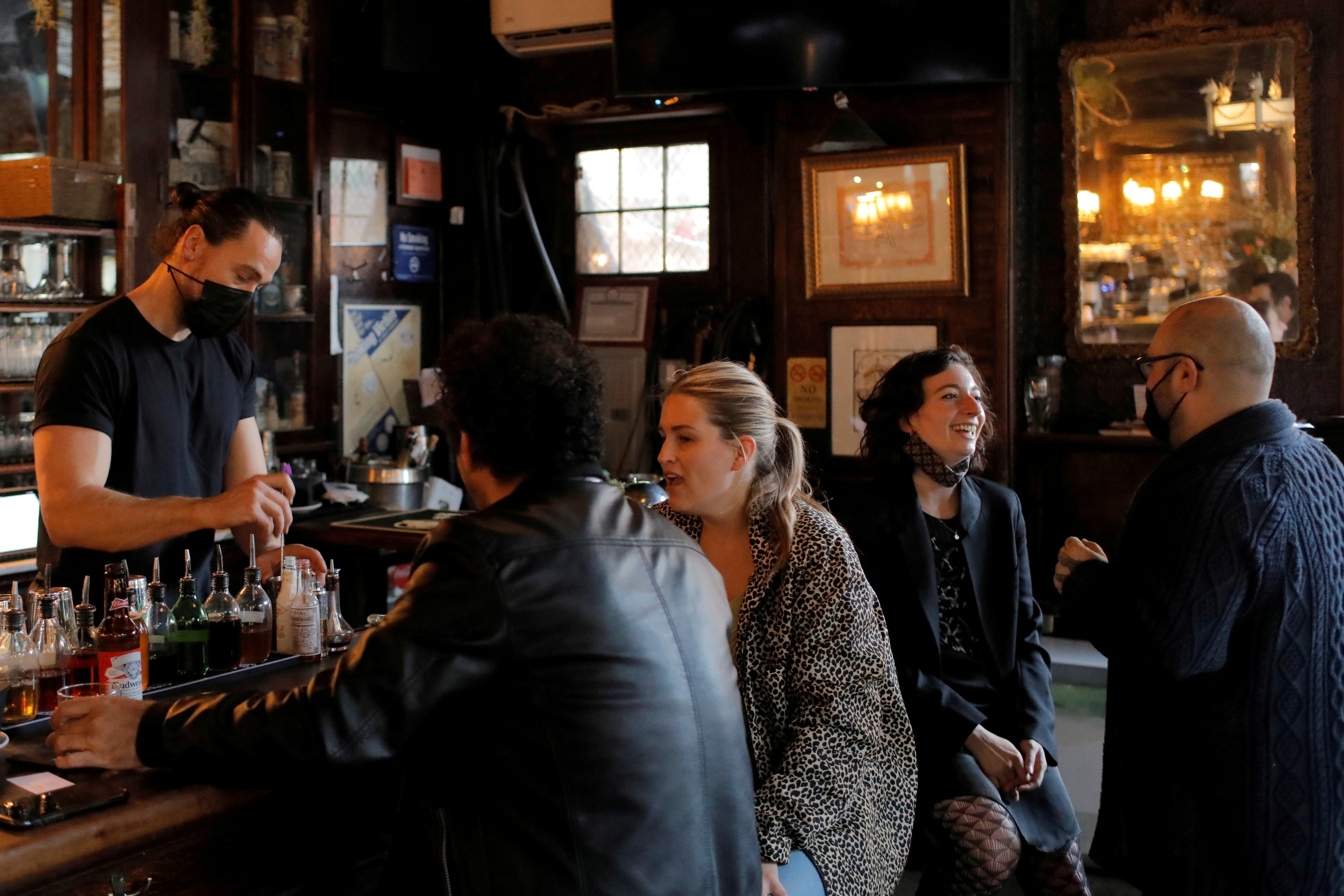 People gather at the White Horse Tavern (est. 1880) as restrictions eased on indoor drinking in bars, allowing seating at the bar, during the outbreak of the coronavirus disease (COVID-19) in Manhattan, New York City, New York, U.S., May 3, 2021. REUTERS/Andrew Kelly/File Photo