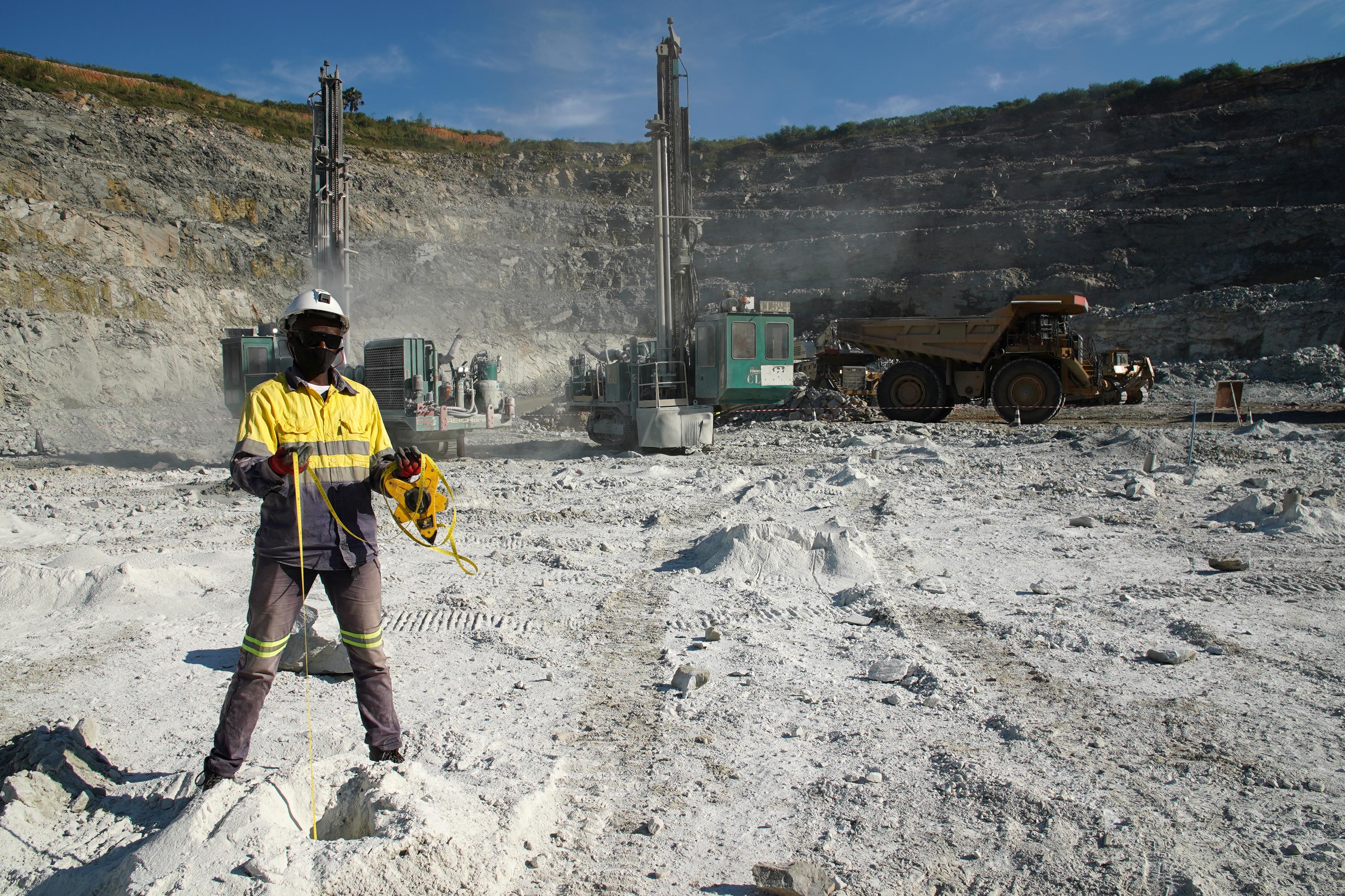 A miner measures the depth of blast holes at the Kibali gold mine Haut-Uele province, Democratic Republic of Congo October 8, 2021 . REUTERS/Hereward Holland