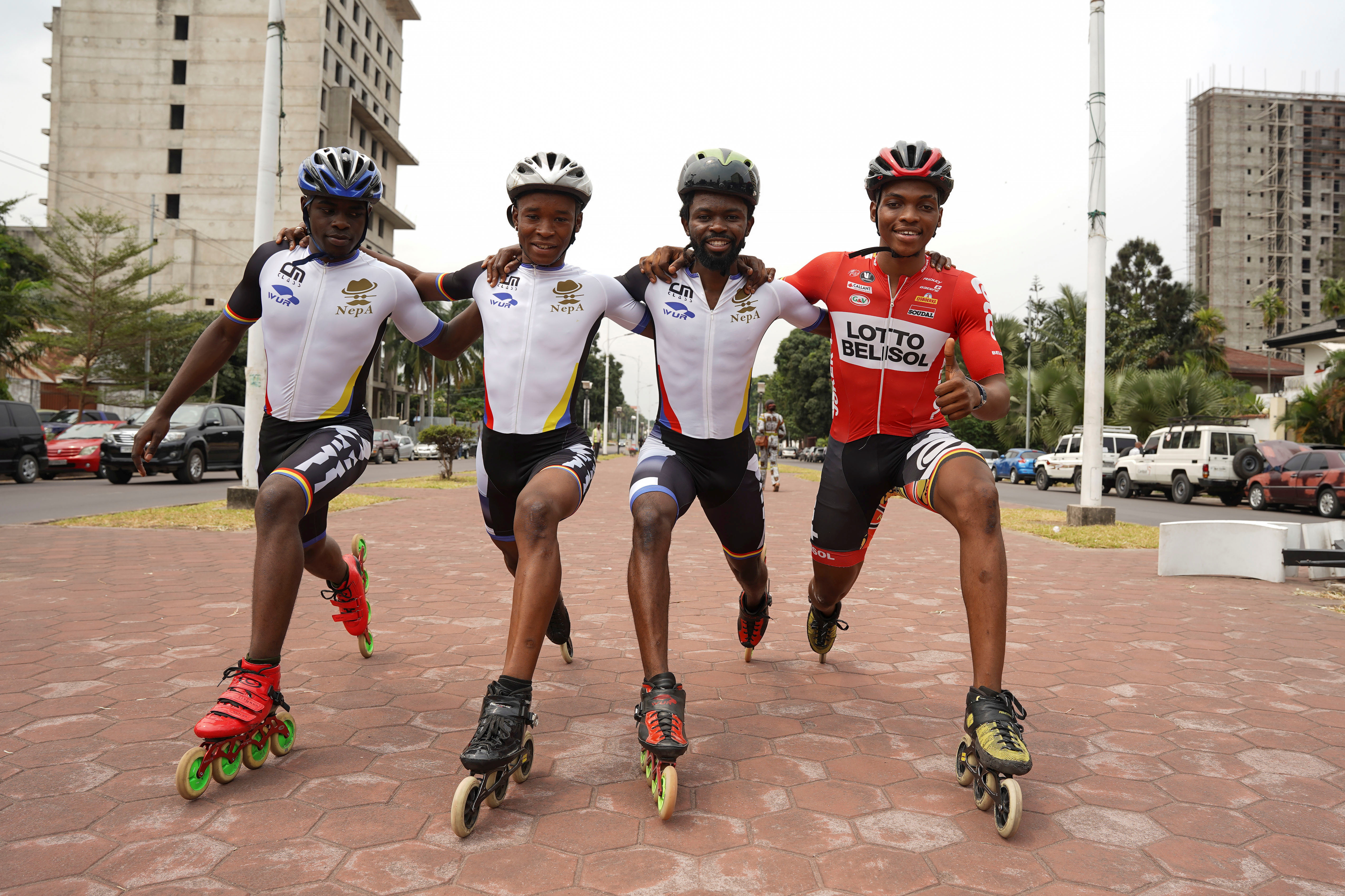 Serge Makolo poses for a photo with his speed skating teammates in Kinshasa, Democratic Republic of Congo, September 16, 2021. REUTERS/Hereward Holland