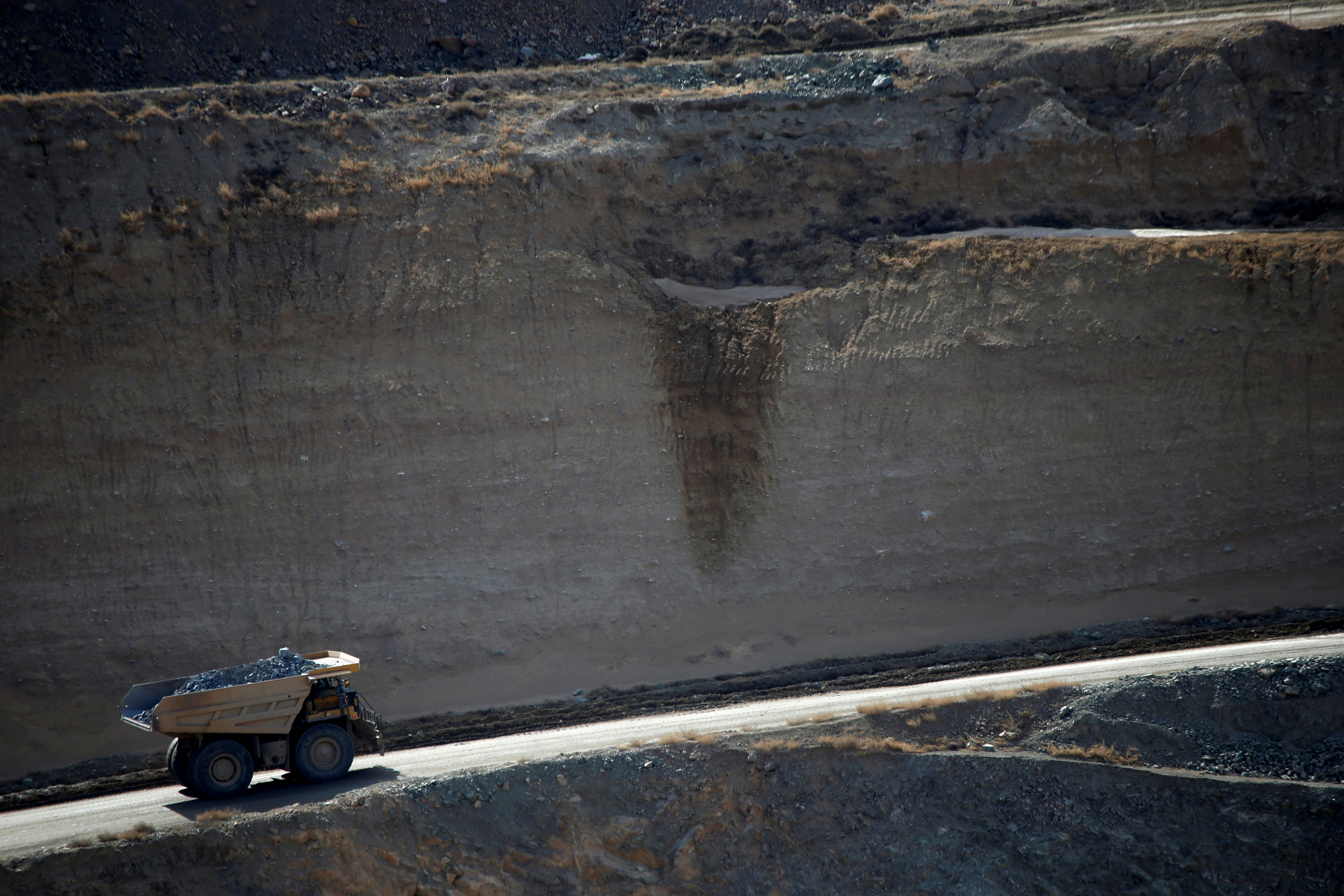 A mining truck takes ore from the open-pit mine at the MP Materials rare earth mine in Mountain Pass, California, U.S. January 30, 2020. REUTERS/Steve Marcus