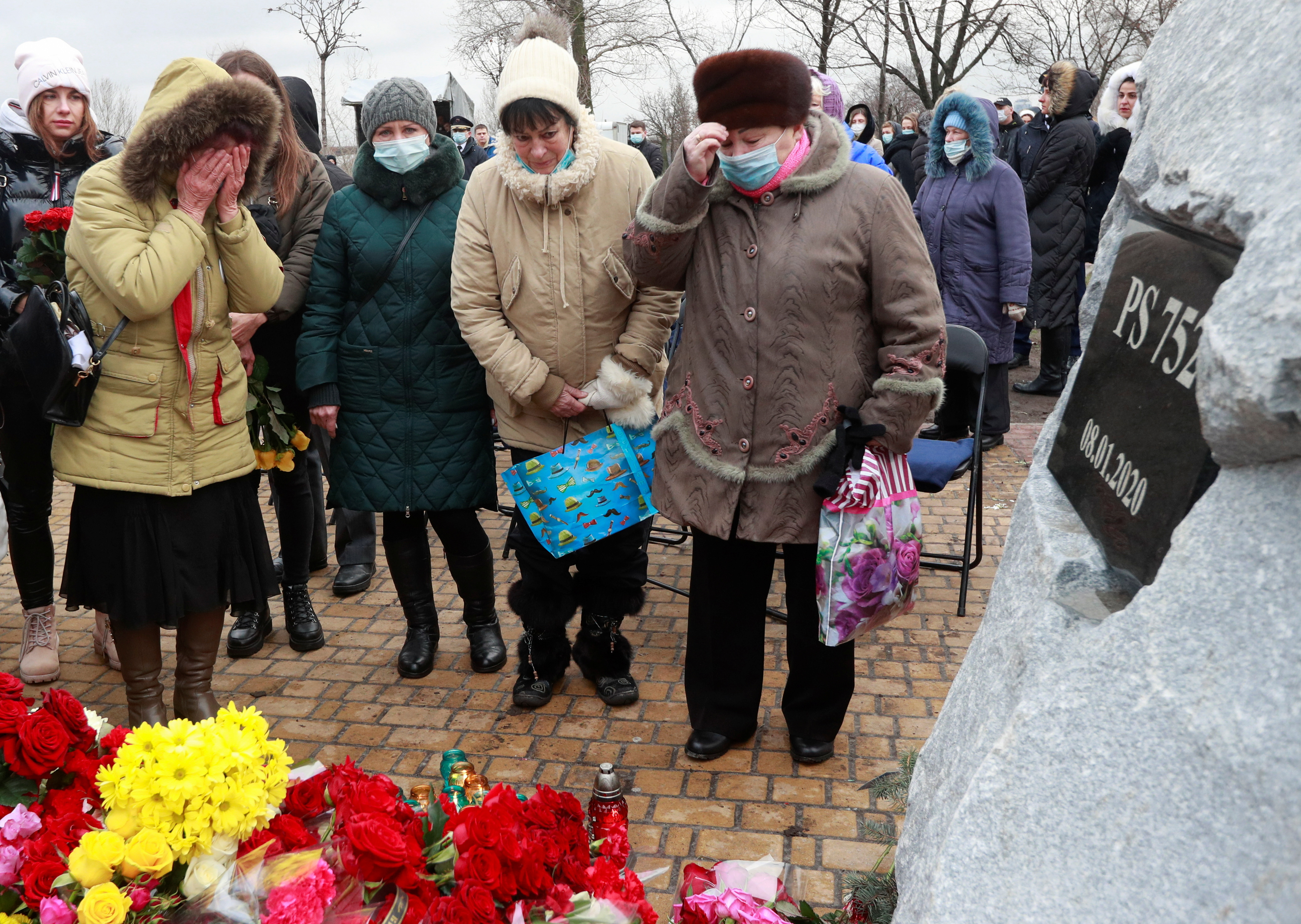 People attend a commemorative ceremony, which marks the first anniversary of the Ukraine International Airlines flight PS752 downing in Iranian airspace, in Kyiv, Ukraine January 8, 2021. REUTERS/Valentyn Ogirenko