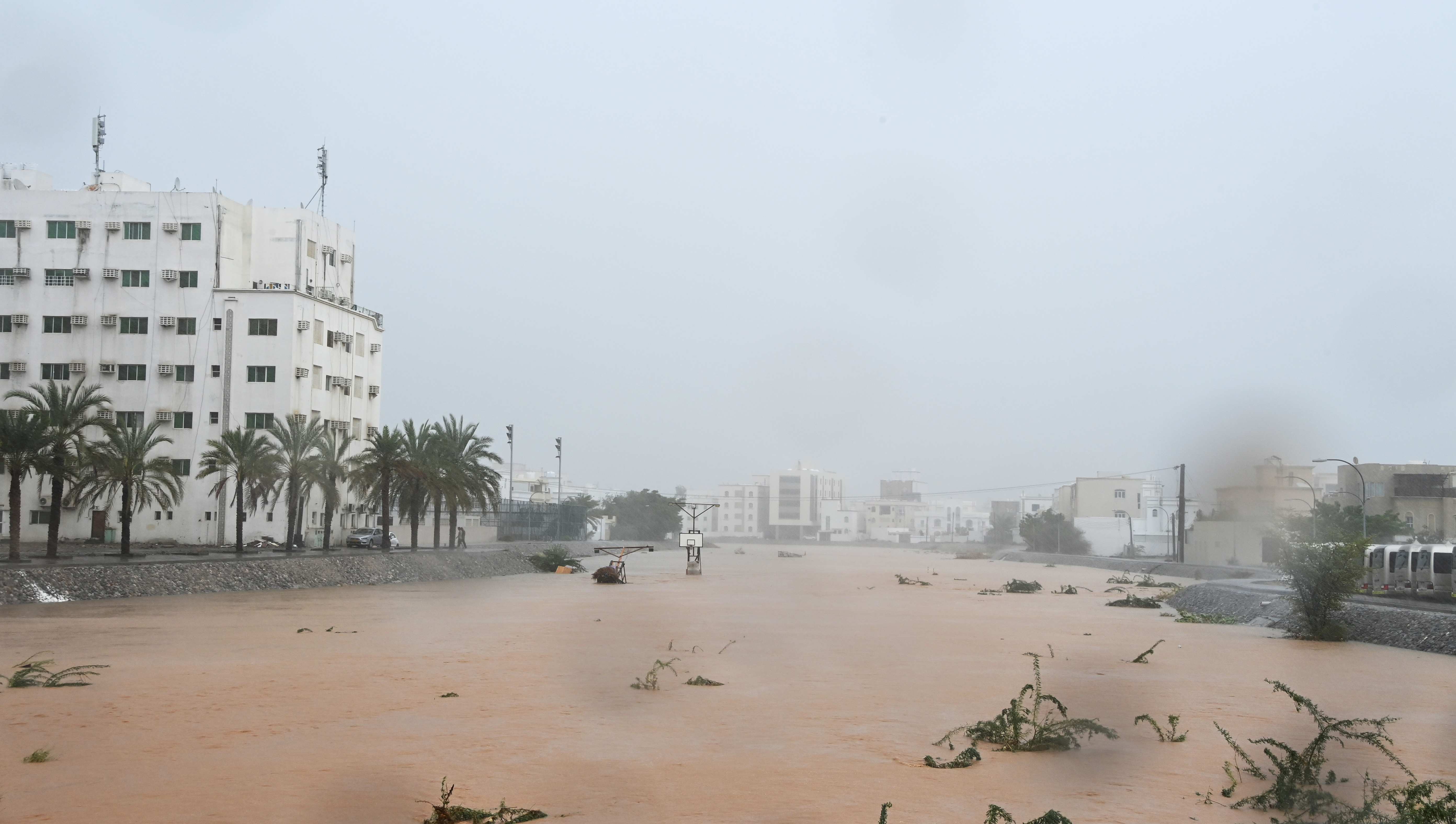 Flooded streets are seen as Cyclone Shaheen makes landfall in Muscat Oman, October 3, 2021. REUTERS/Sultan Al Hassani