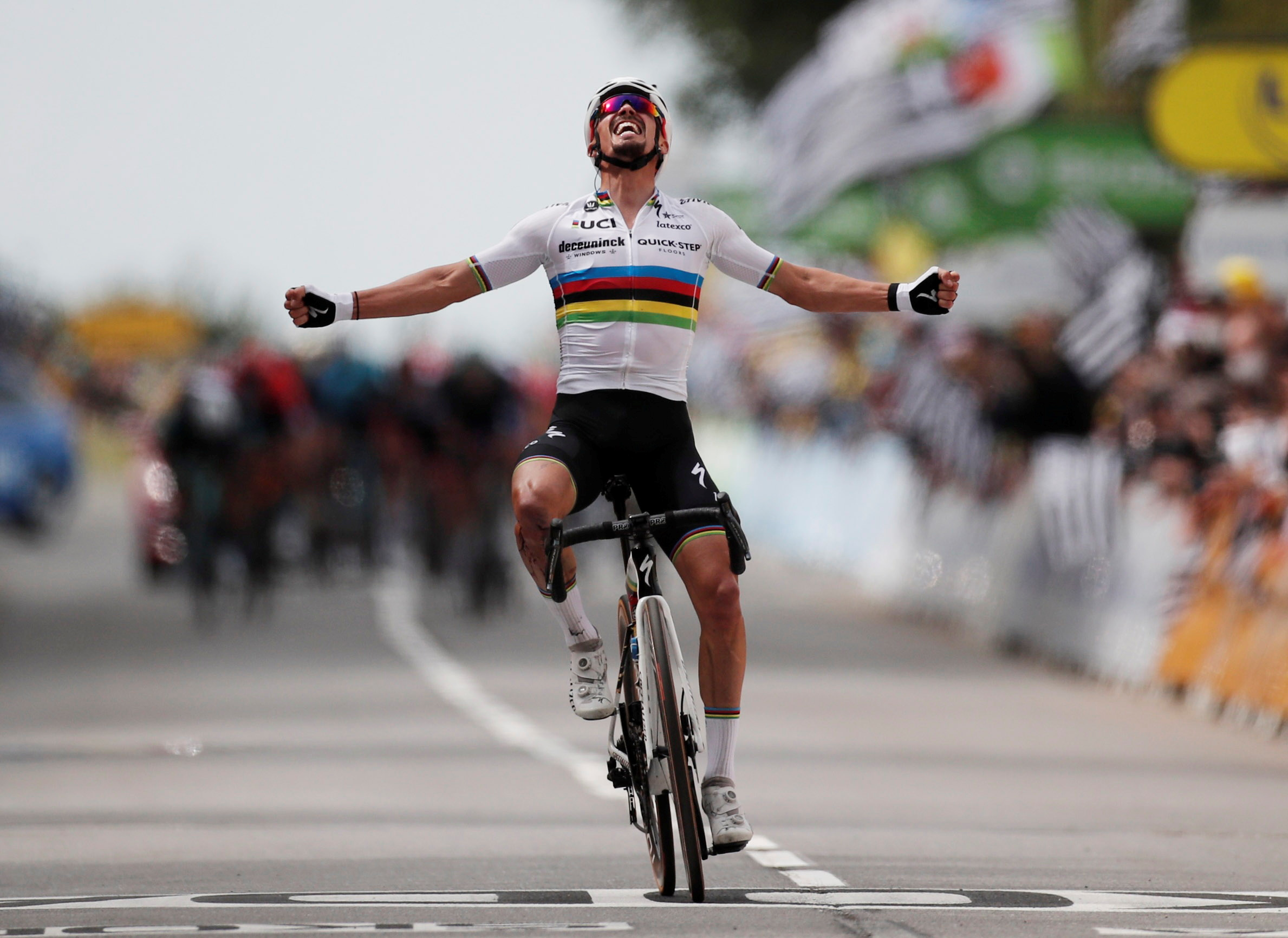 Cycling - Tour de France - Stage 1 - Brest to Landerneau - France - June 26, 2021 Deceuninck–Quick-Step rider Julian Alaphilippe of France celebrates as he crosses the finish line to win the first stage Pool via REUTERS/Benoit Tessier