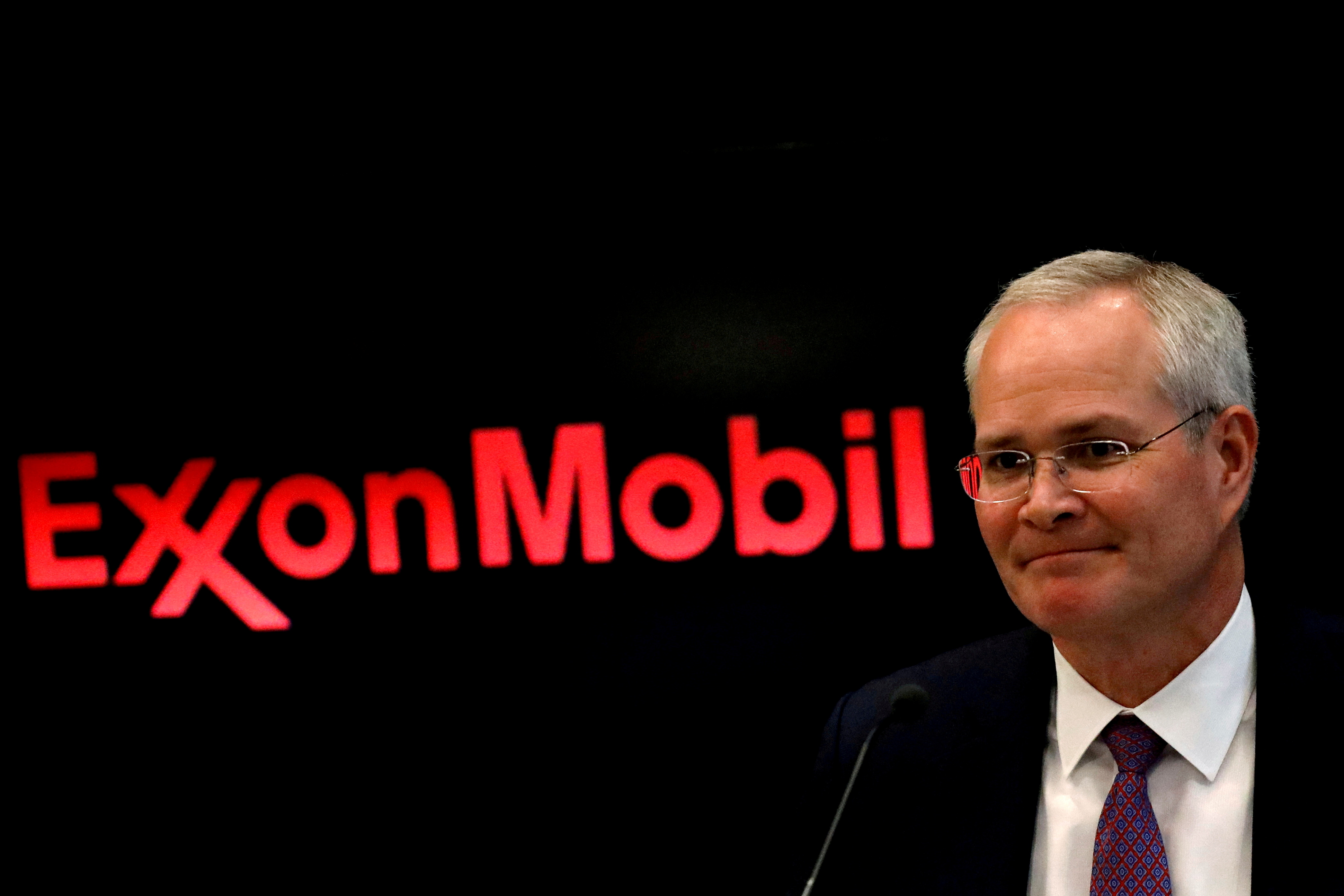 Darren Woods, Chairman & CEO of Exxon Mobil Corporation, attends a news conference at the New York Stock Exchange (NYSE) in New York, U.S., March 1, 2017. REUTERS/Brendan McDermid/File Photo