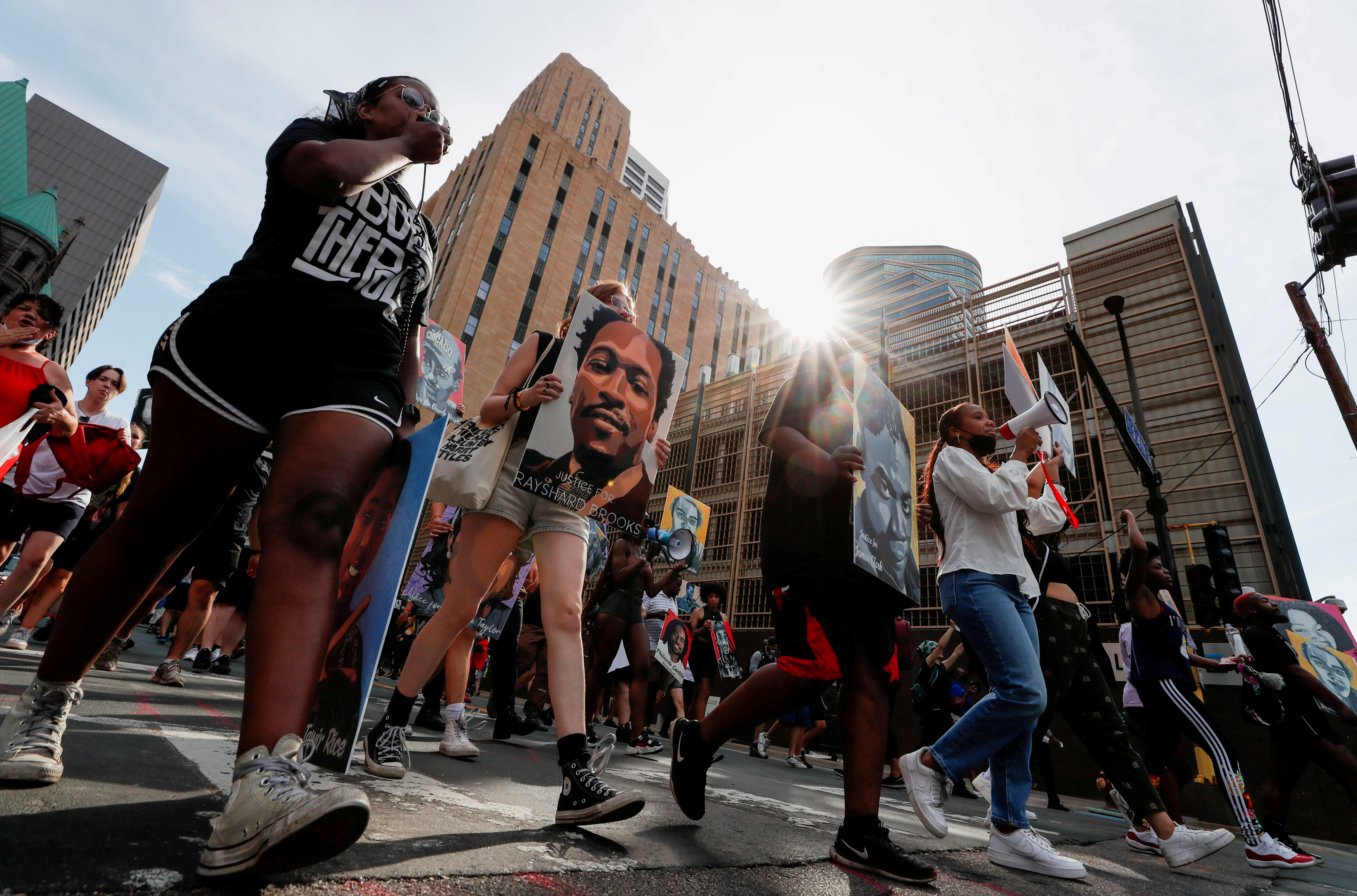 Protesters march during a brief rally after the sentencing of Derek Chauvin, the former Minneapolis policeman found guilty of killing George Floyd, a Black man, in Minneapolis, Minnesota, U.S. June 25, 2021. REUTERS/Eric Miller/File Photo
