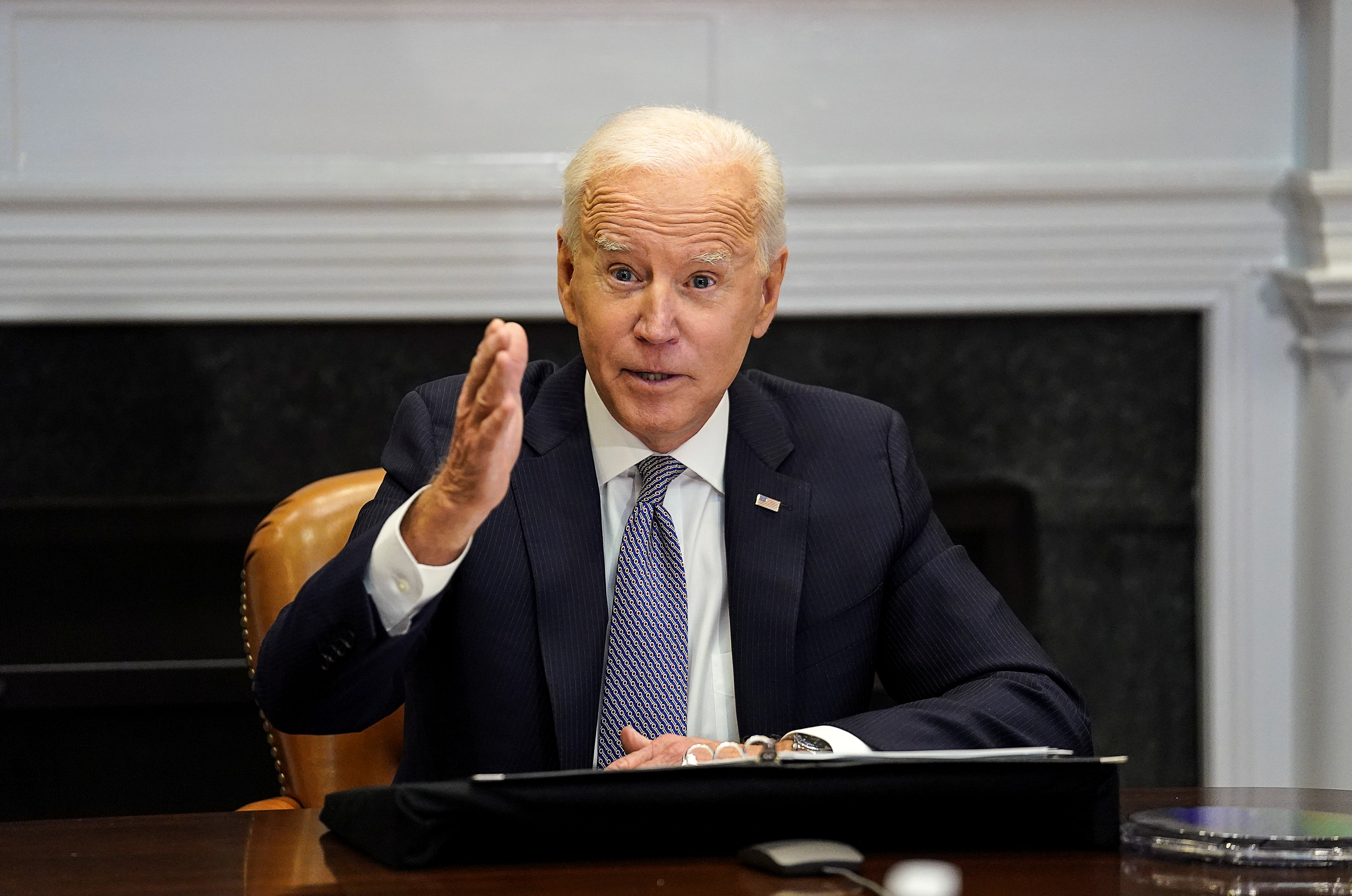 U.S. President Joe Biden speaks as he participates in the virtual CEO Summit on Semiconductor and Supply Chain Resilience from the Roosevelt Room at the White House in Washington, U.S., April 12, 2021. REUTERS/Kevin Lamarque