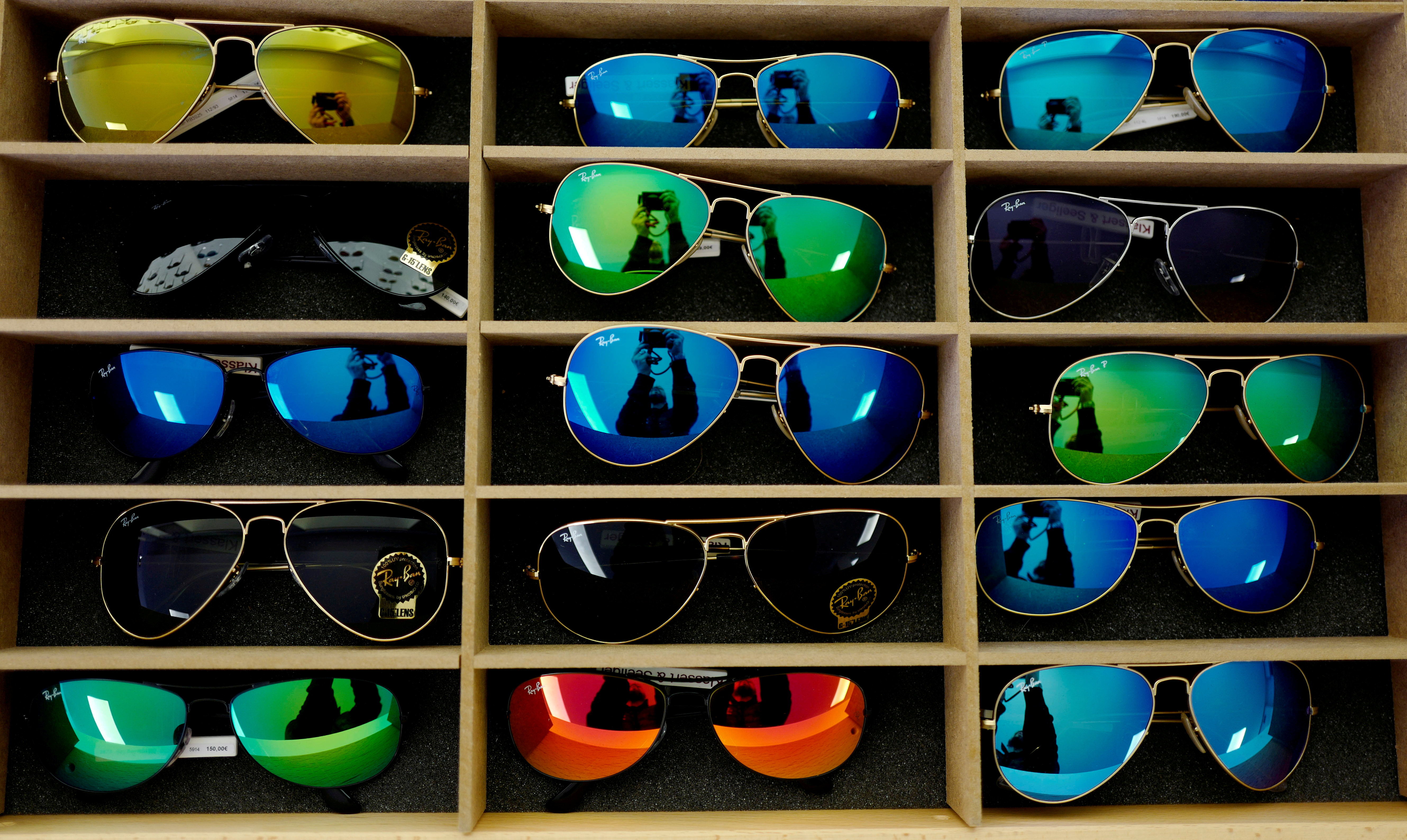Sunglasses from Ray Ban are on display at a optician shop in Hanau near Frankfurt, Germany, March 18, 2016.  REUTERS/Kai Pfaffenbach