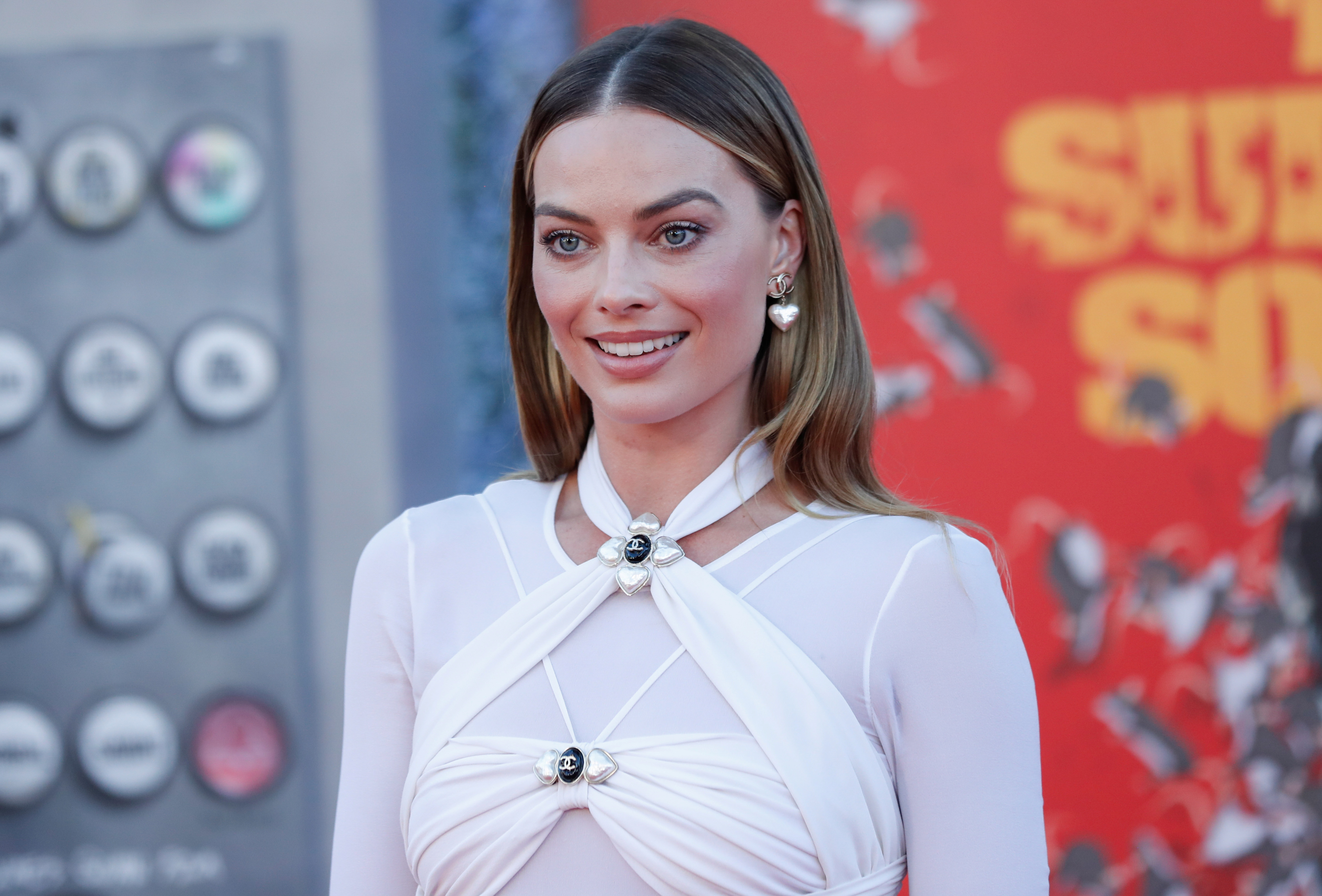 Cast member Margot Robbie poses at the premiere for the film