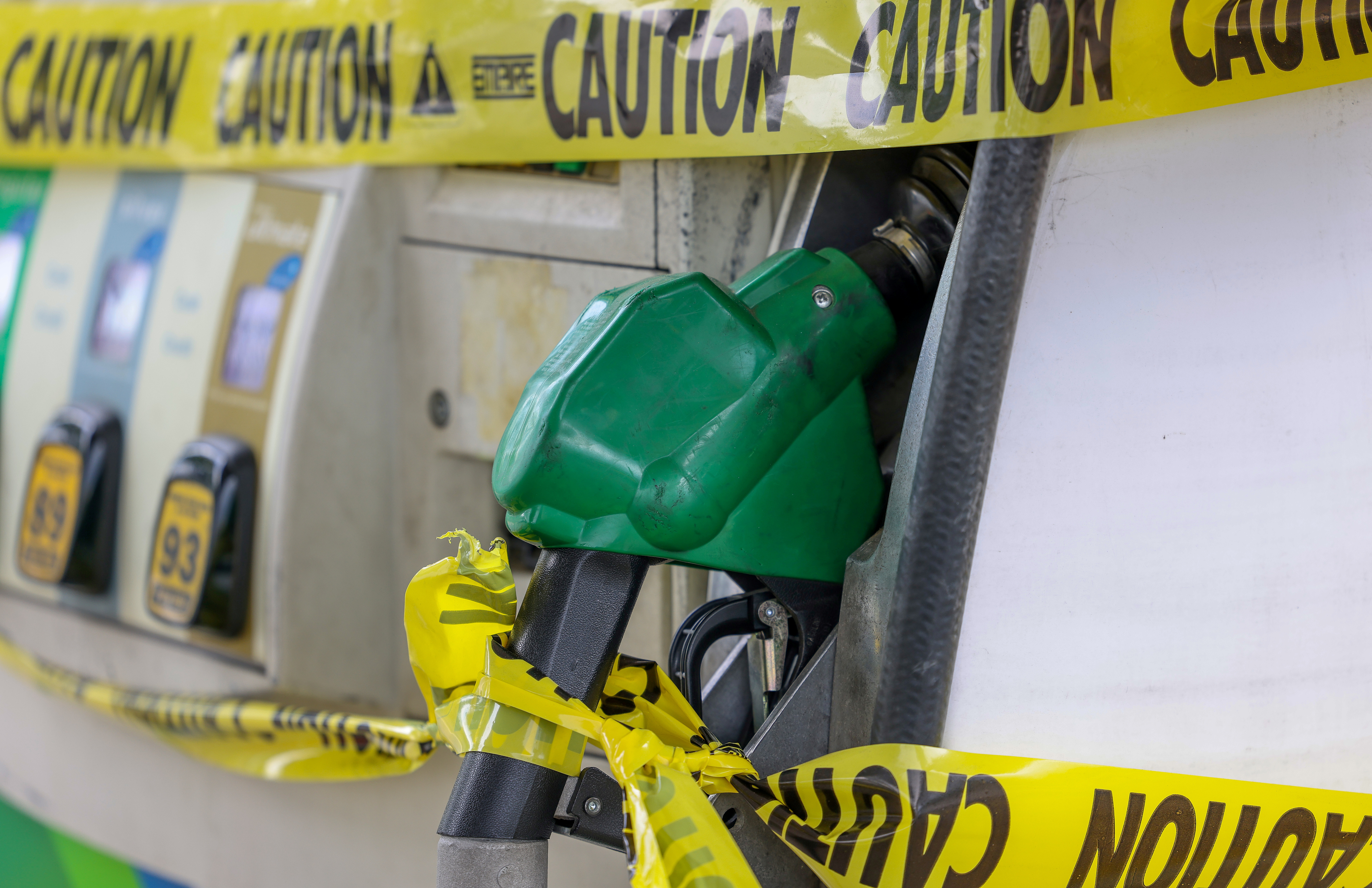 Gas pumps are roped off  with a tape indicating a lack of gasoline at a gas station in Washington, U.S., May 14, 2021. REUTERS/Evelyn Hockstein/File Photo