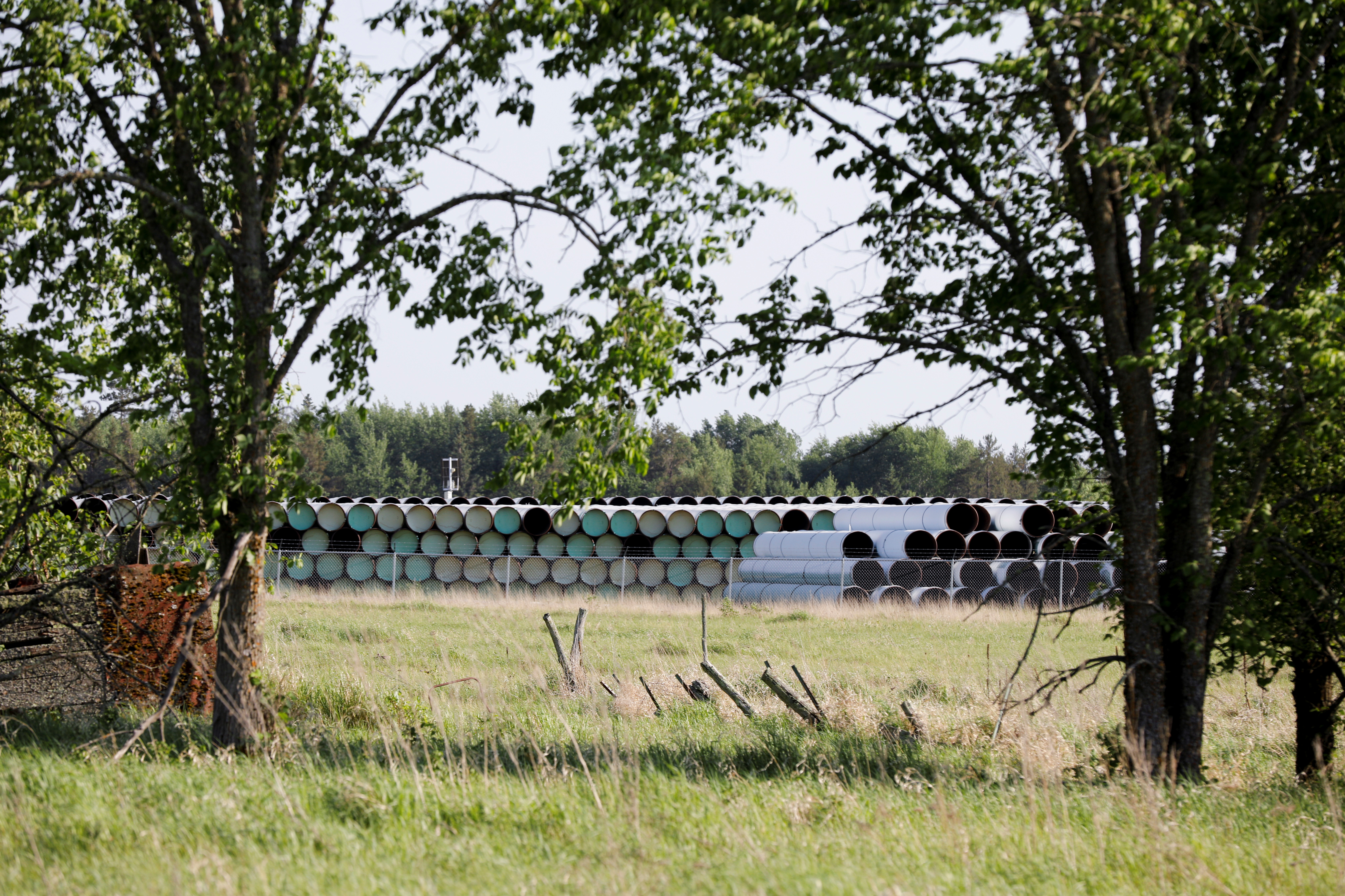 Enbridge Line 3 pipes are stored near Park Rapids on the second day of the Treaty People Gathering, an organized protest of the Line 3 pipeline, built by Enbridge Energy, in Park Rapids, Minnesota, U.S., June 6, 2021.  REUTERS/Nicholas Pfosi