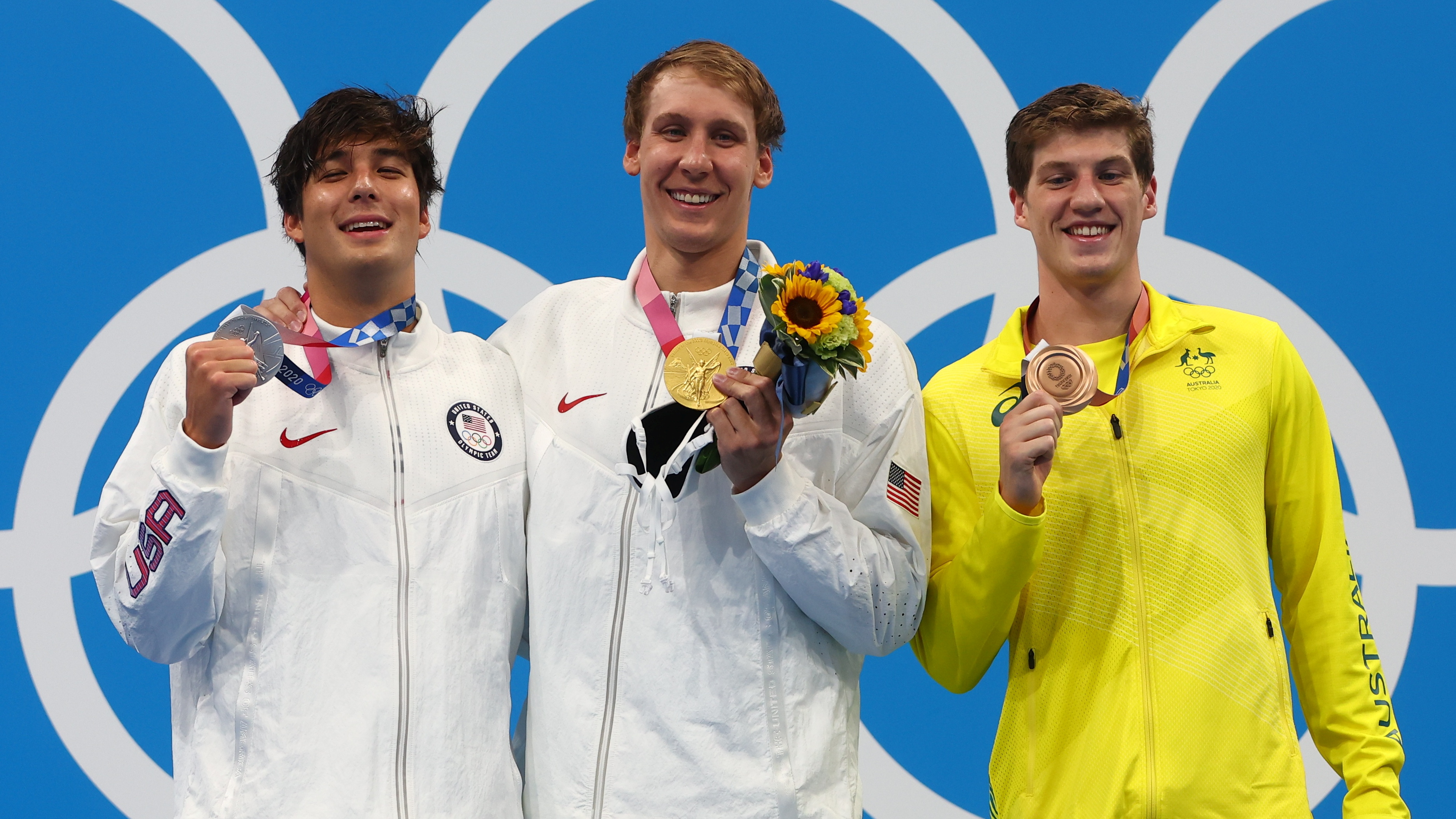Tokyo 2020 Olympics - Swimming - Men's 400m Individual Medley - Medal Ceremony - Tokyo Aquatics Centre - Tokyo, Japan - July 25, 2021. Gold medalist Chase Kalisz of the United States, silver medalist Jay Litherland of the United States and bronze medalist Brendon Smith of Australia pose on the podium REUTERS/Kai Pfaffenbach