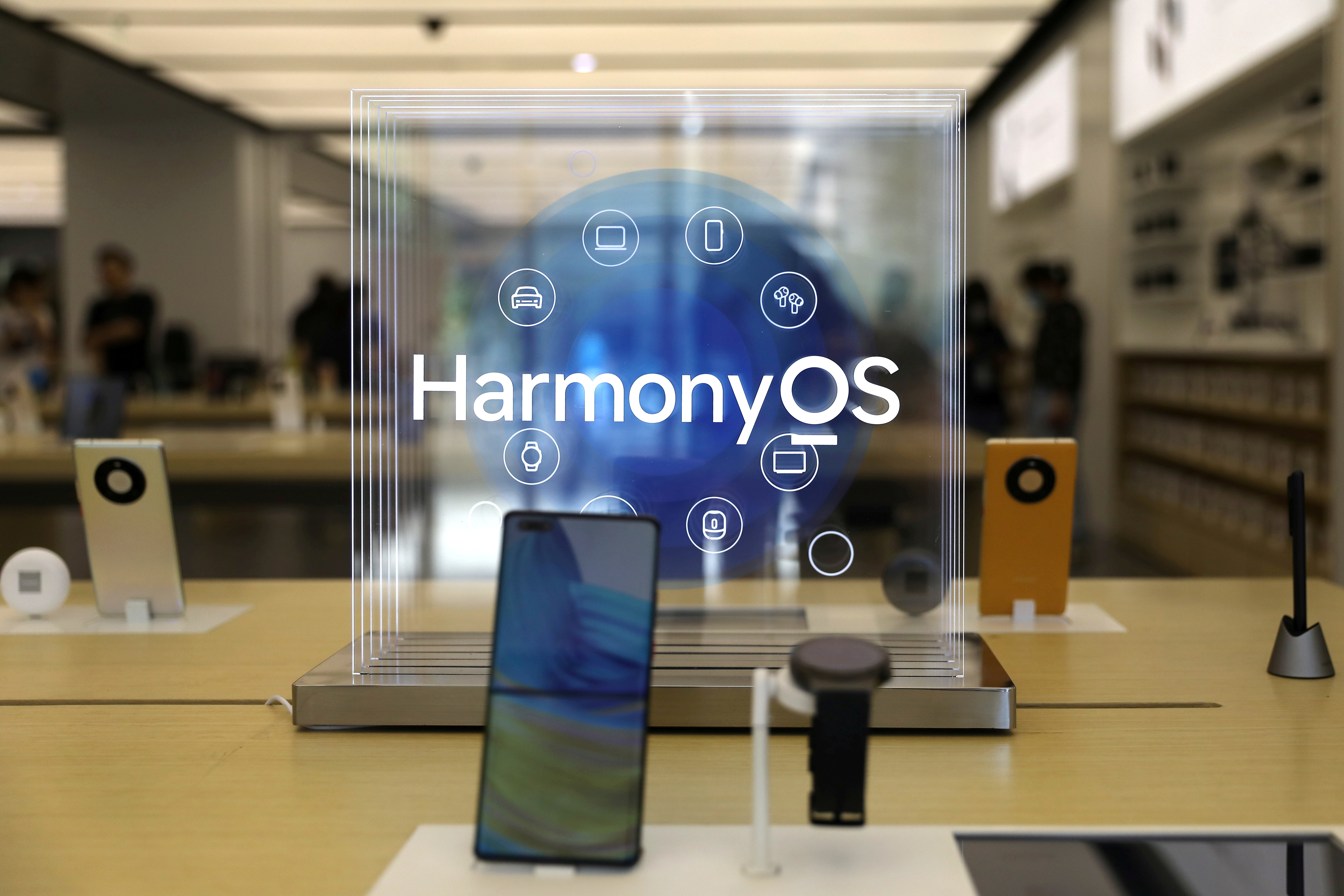 A Huawei Mate 40 smartphone installed with Huawei's operating system HarmonyOS is displayed at a Huawei store in Beijing, China June 3, 2021. REUTERS/Tingshu Wang