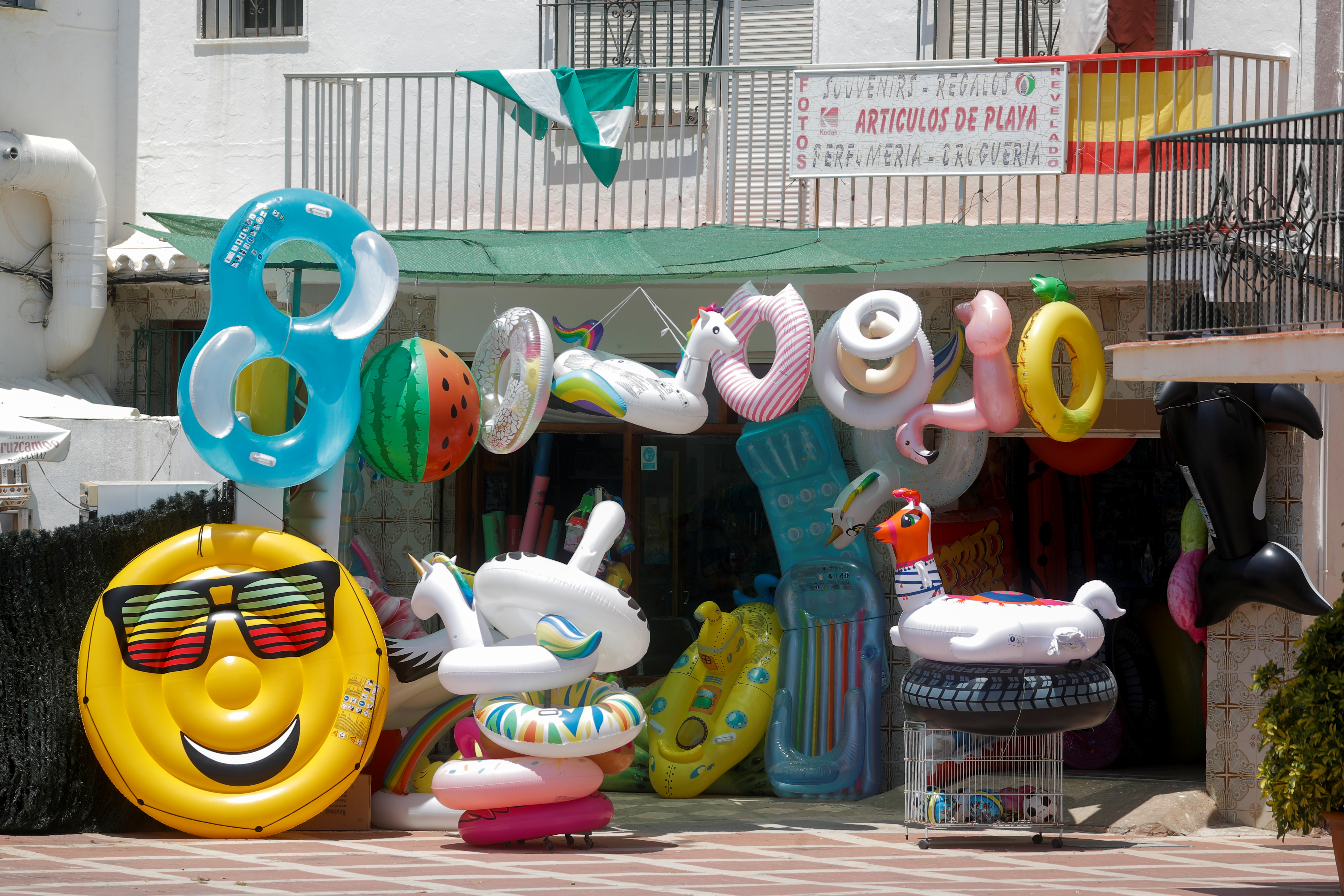 Air mattresses are displayed outside a shop, amid the coronavirus disease (COVID-19) outbreak in Torremolinos, Spain, July 19, 2021. REUTERS/Jon Nazca/Files