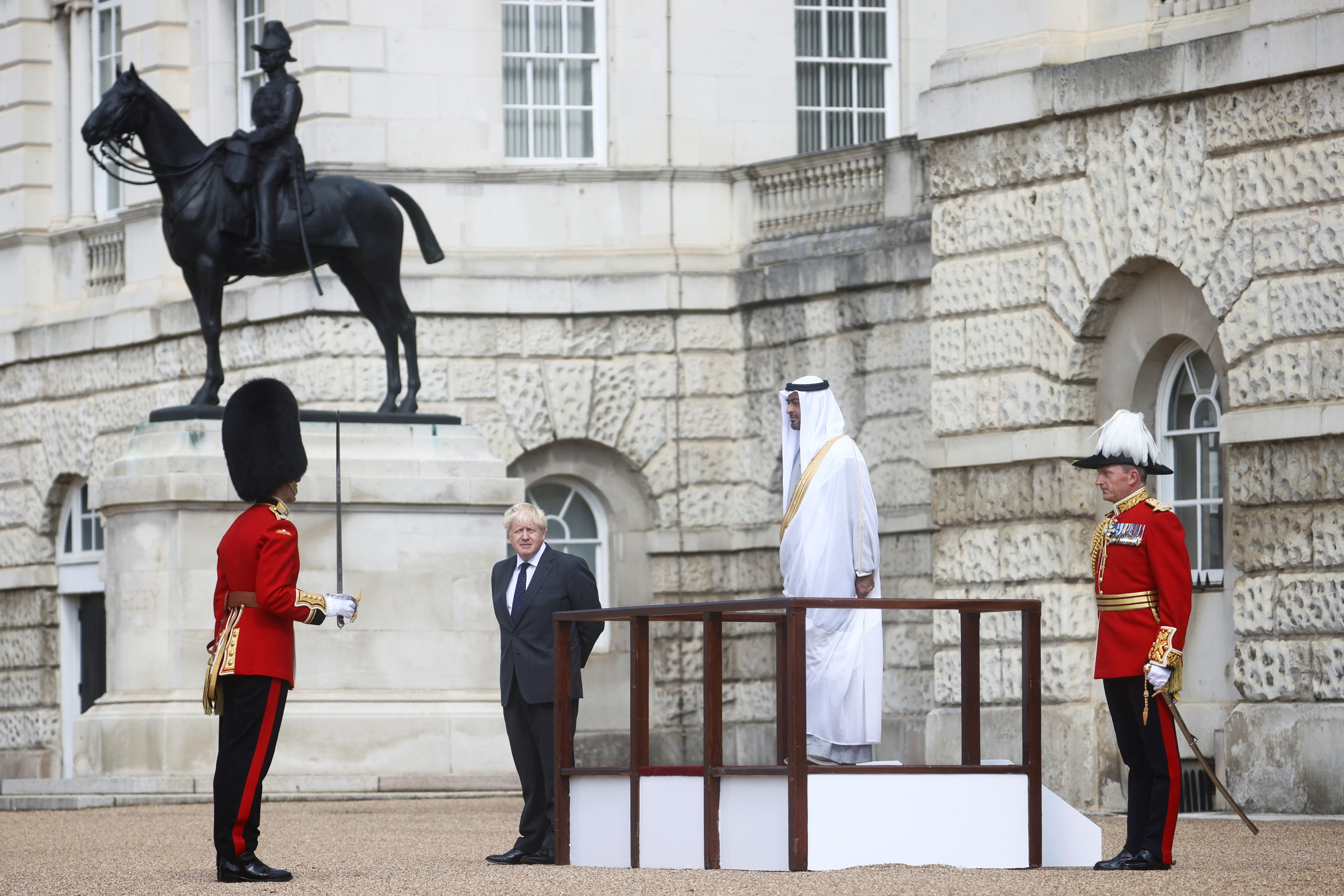 Britain's Prime Minister Boris Johnson and Abu Dhabi's Crown Prince Sheikh Mohammed bin Zayed al-Nahyan inspect the Grenadier Guard in London, Britain, September 16, 2021. REUTERS/Hannah McKay/Pool