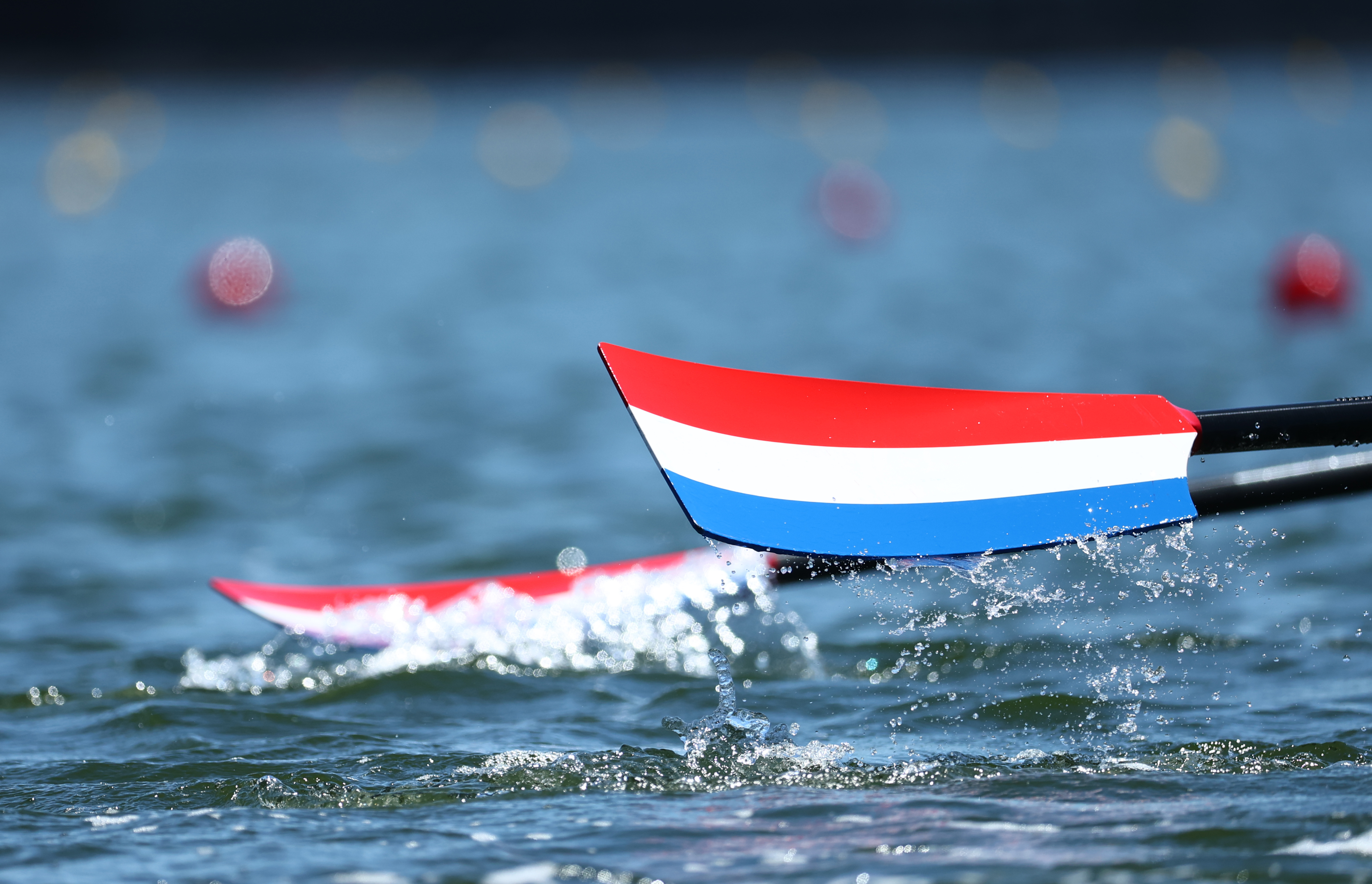 Tokyo 2020 Olympics - Rowing Training Sessions - Sea Forest Waterway, Tokyo, Japan - July 18, 2021 General view of an oar in the Netherlands flag colours during a training session REUTERS/Thomas Peter