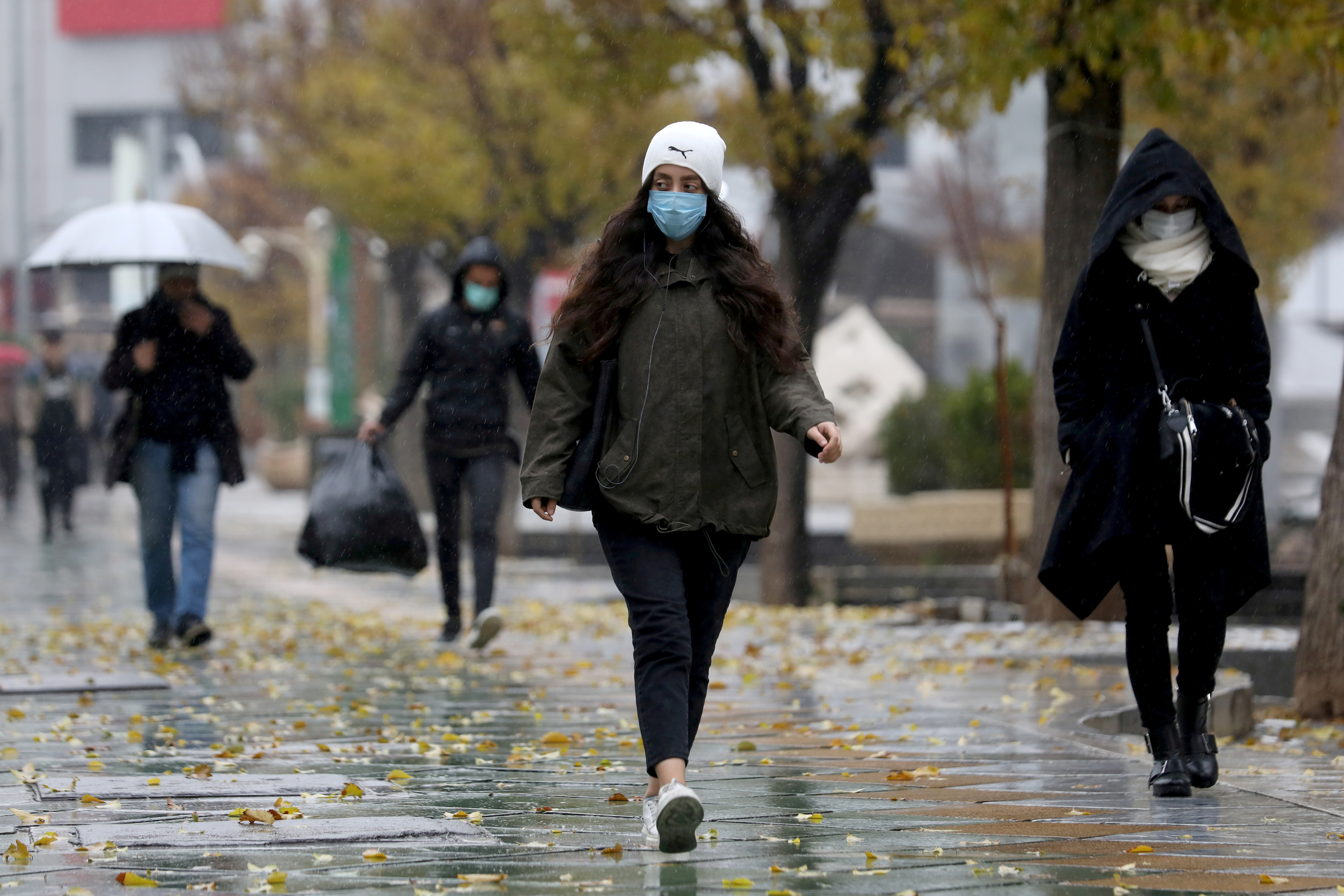 People walk on a street after Tehran reopened following a two-week shutdown,  Iran December 6, 2020. Majid Asgaripour/WANA (West Asia News Agency) via REUTERS