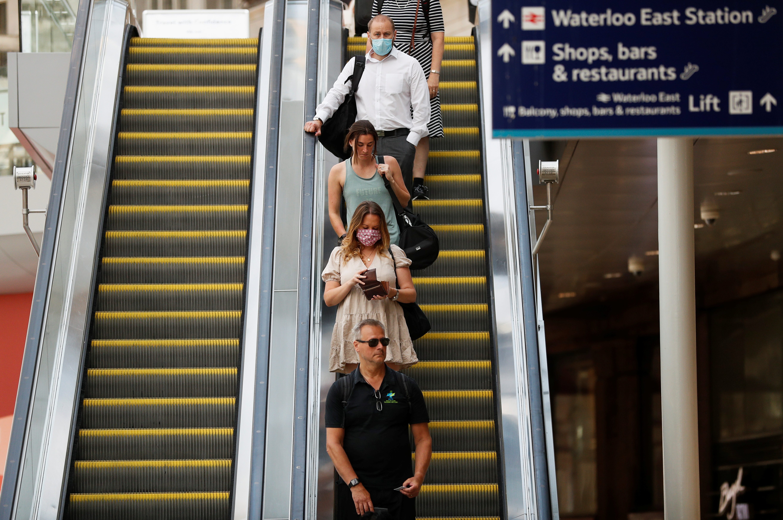 Commuters use an escalator at Waterloo station, amid the coronavirus disease (COVID-19) pandemic, London, Britain, July 19, 2021. REUTERS/Peter Nicholls