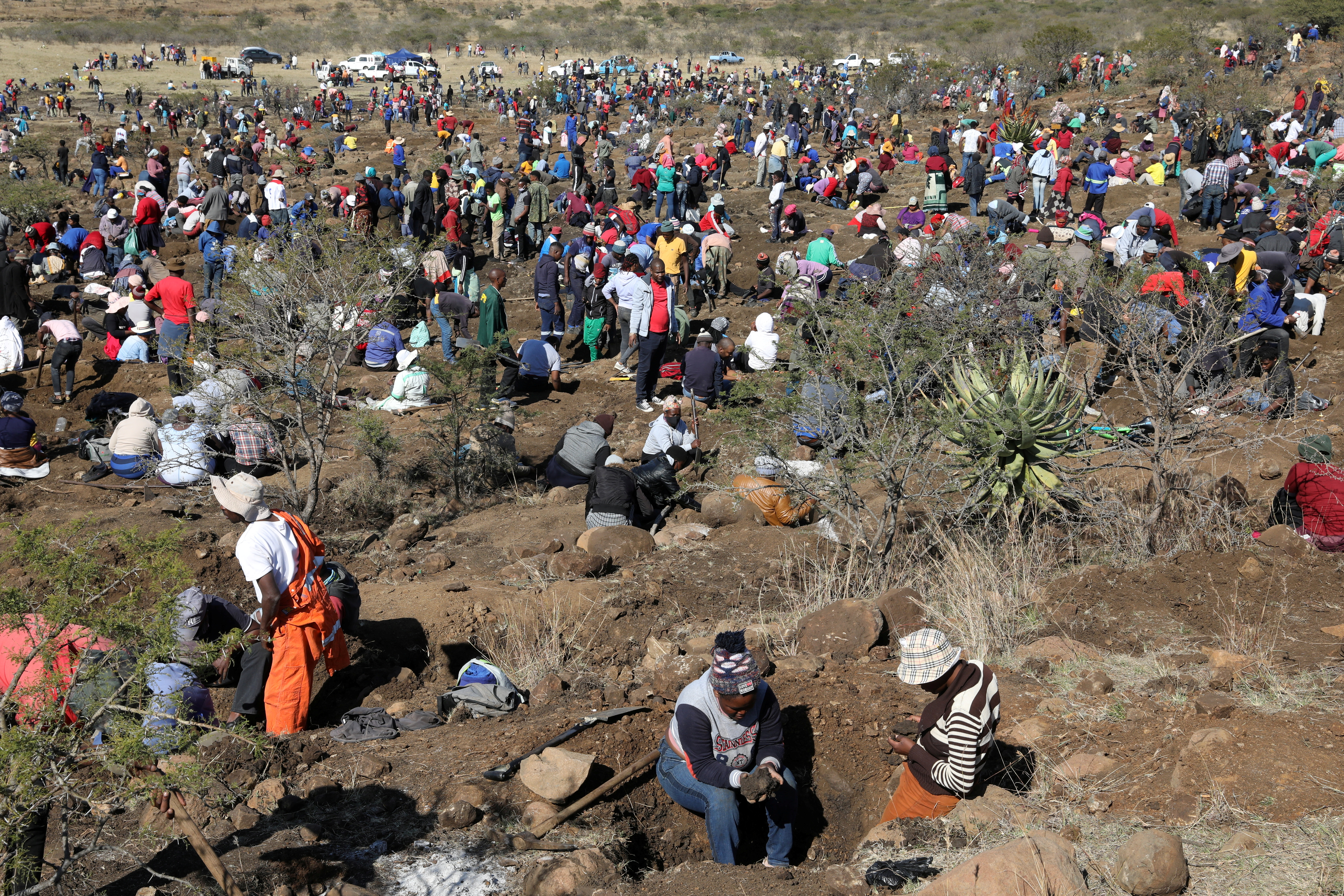 Fortune seekers are seen as they flock to the village after pictures and videos were shared on social media showing people celebrating after finding what they believe to be diamonds, in the village of KwaHlathi outside Ladysmith, in KwaZulu-Natal province, South Africa, June 14, 2021. REUTERS/Siphiwe Sibeko/File Photo