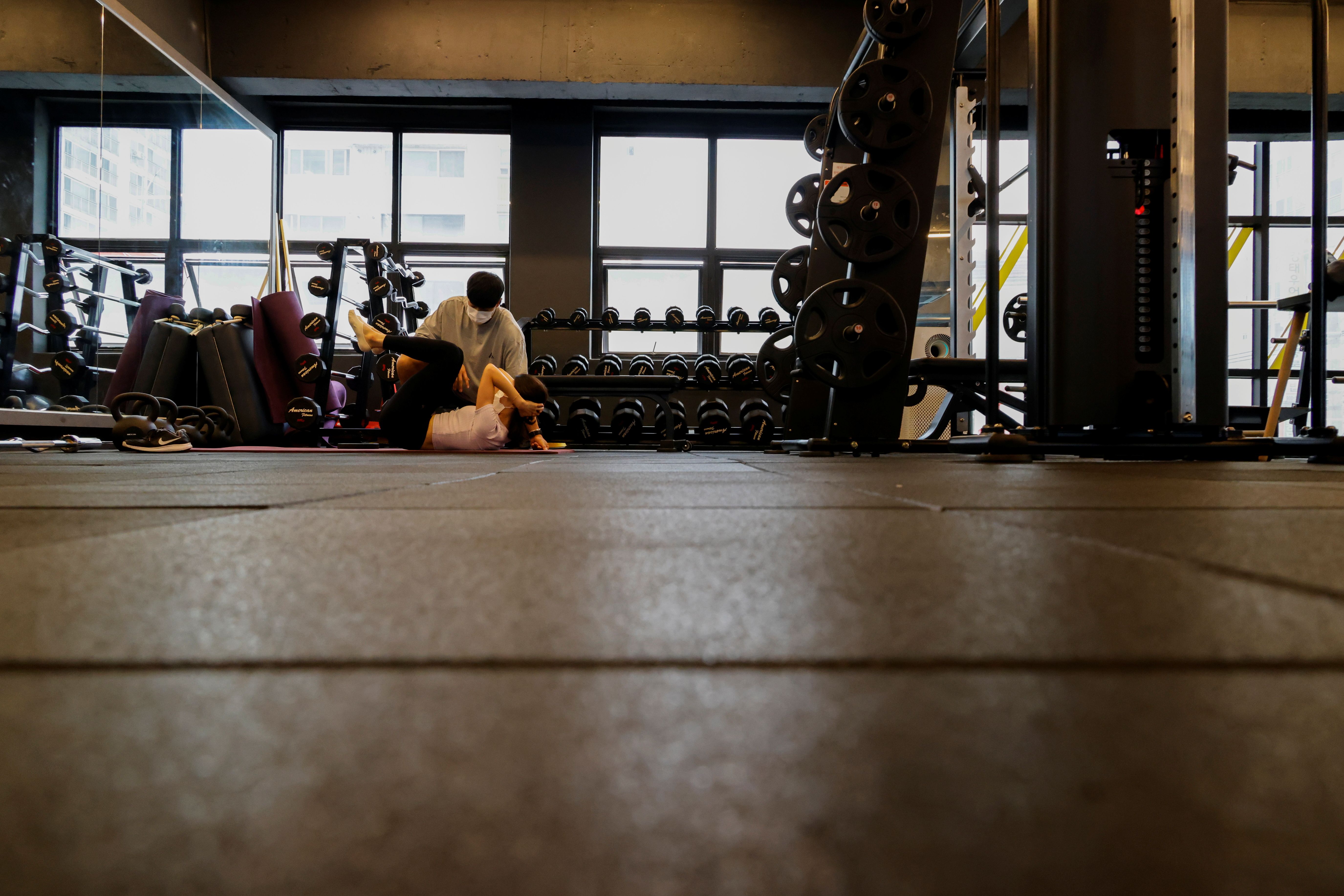 A gym member trains in a fitness club amid the coronavirus disease (COVID-19) pandemic in Seoul, South Korea, July 12, 2021. REUTERS/Heo Ran
