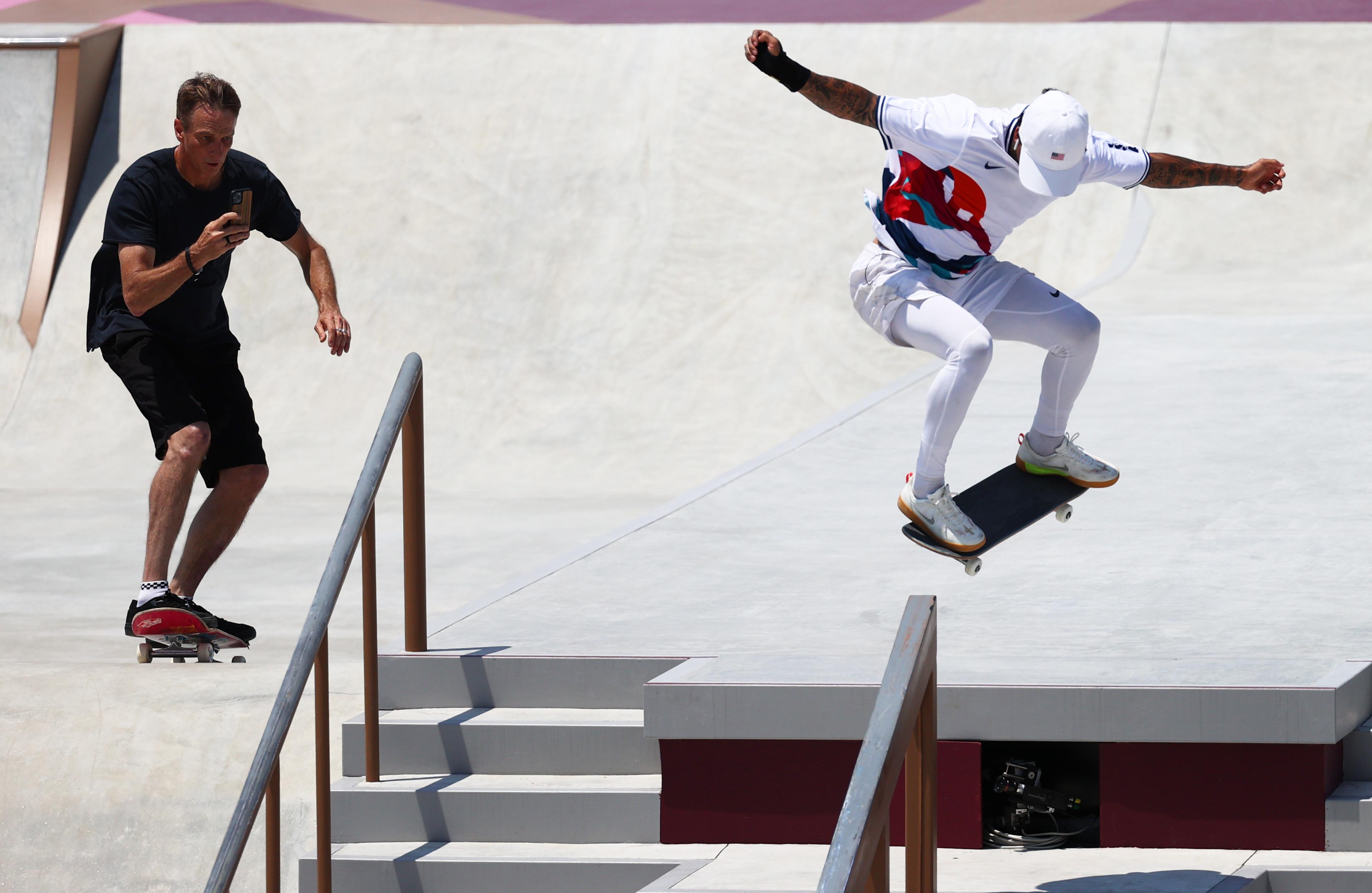 Tokyo 2020 Olympics - Skateboarding Training Session - Ariake Urban Sports Park, Tokyo, Japan - July 24, 2021. Tony Hawk films Nyjah Huston of the United States during training REUTERS/Lucy Nicholson