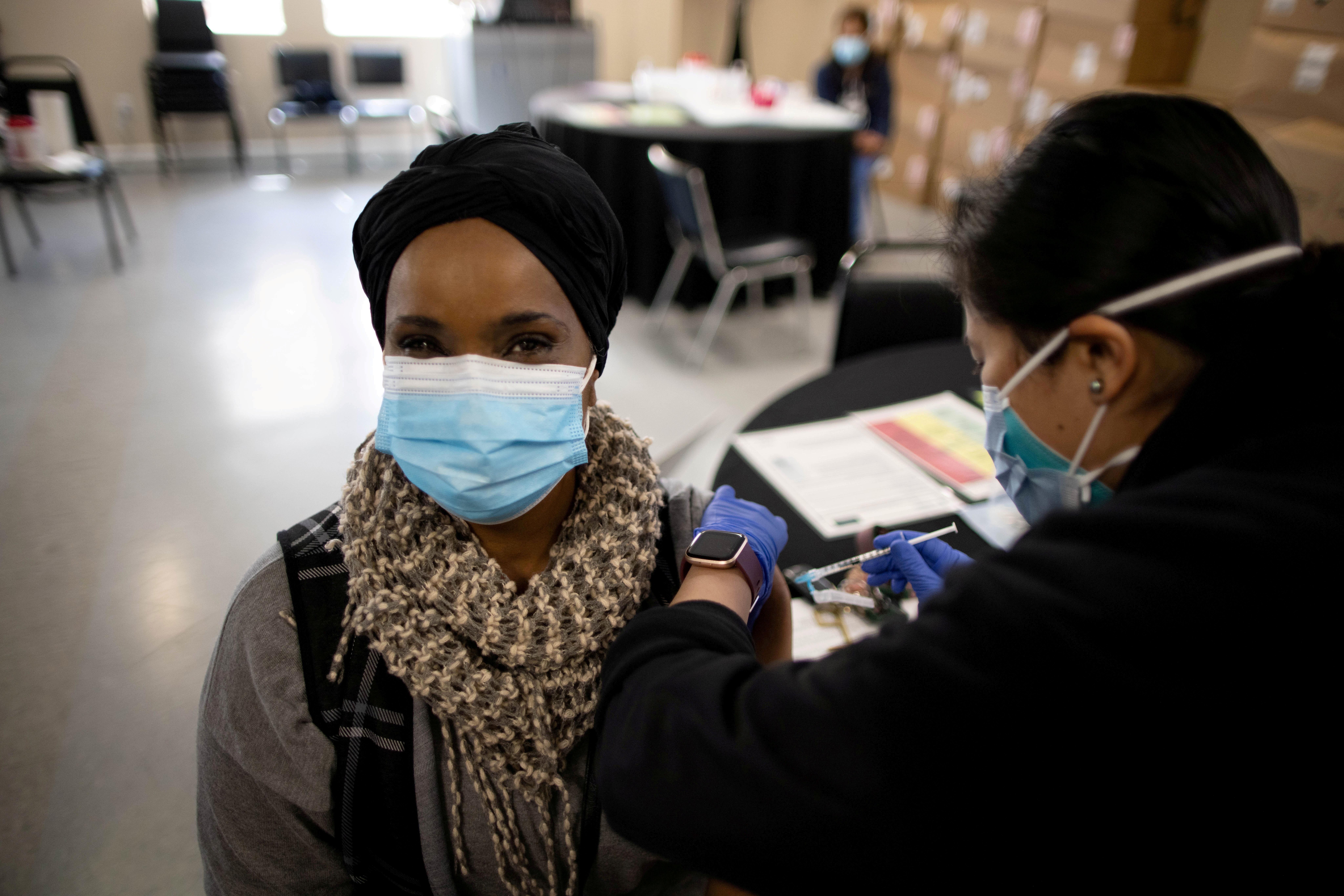Marla Brandon-Stewart receives a second coronavirus disease (COVID-19) vaccination, in Los Angeles, California, U.S., March 12, 2021. REUTERS/Lucy Nicholson/File Photo