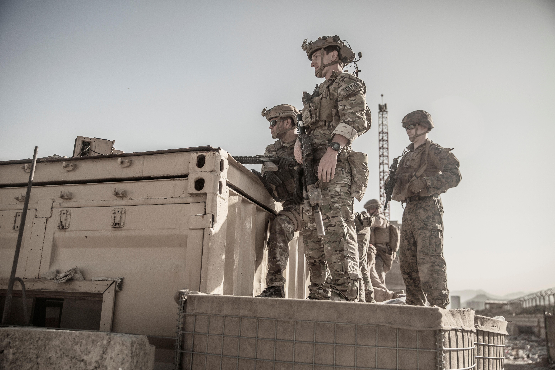 U.S. service members assist at an Evacuation Control Check Point (ECC) during an evacuation at Hamid Karzai International Airport, Kabul, Afghanistan, August 26, 2021. U.S. Marine Corps/Staff Sgt. Victor Mancilla/Handout via REUTERS.