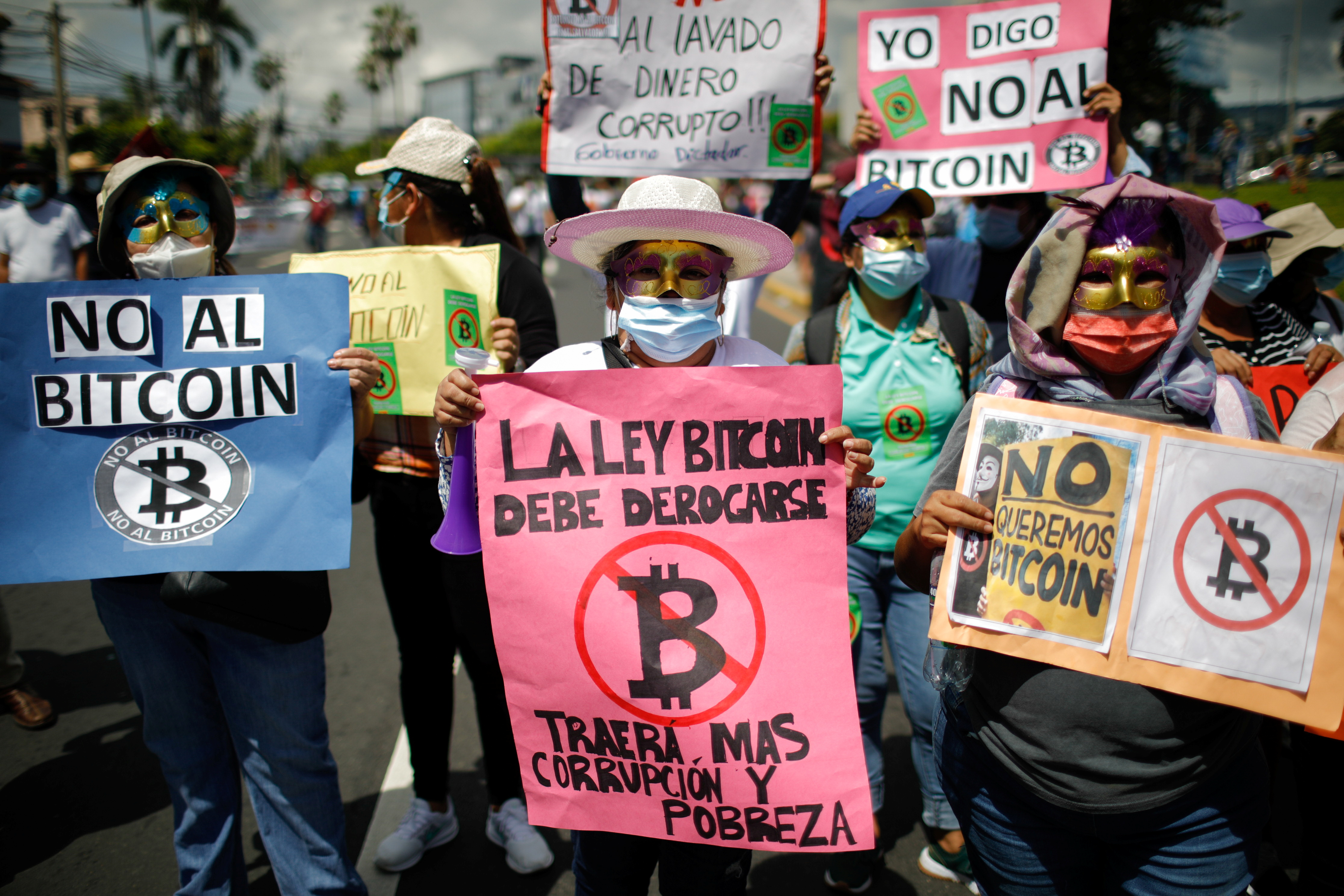 A person holds a sign that reads 'The Bitcoin bill must be repealed, it will bring more corruption and poverty', as people participate in a protest against the use of Bitcoin as legal tender, in San Salvador, El Salvador, September 7, 2021. REUTERS/Jose Cabezas