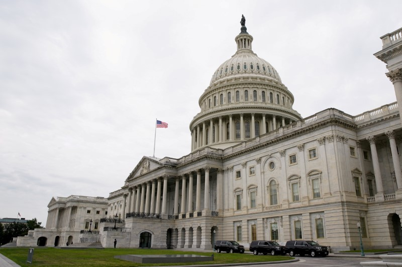 Vehicles are parked outside the U.S. Capitol building the morning the Senate returned to session in Washington, DC, U.S., July 31, 2021. REUTERS/Elizabeth Frantz/File Photo
