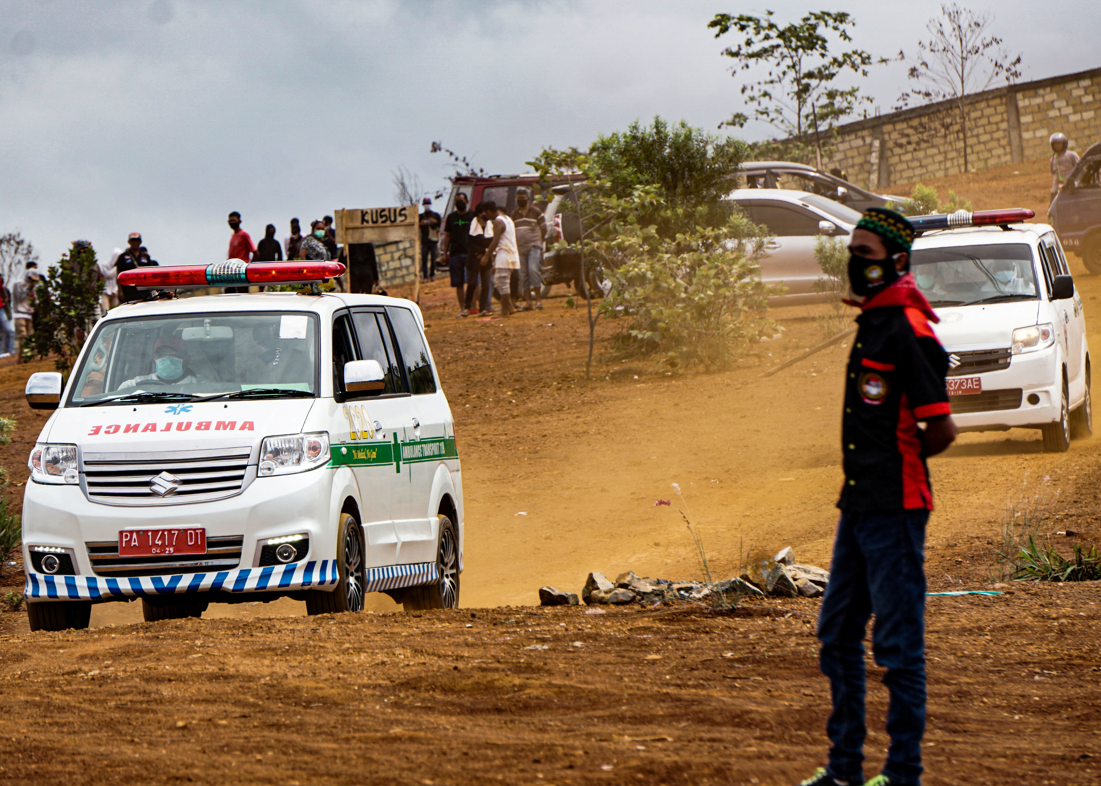 Ambulances are seen at a burial area provided by the government for coronavirus disease (COVID-19) victims, as cases surge in Jayapura, Papua, Indonesia July 20, 2021, in this photo taken by Antara Foto/Indrayadi TH/via REUTERS