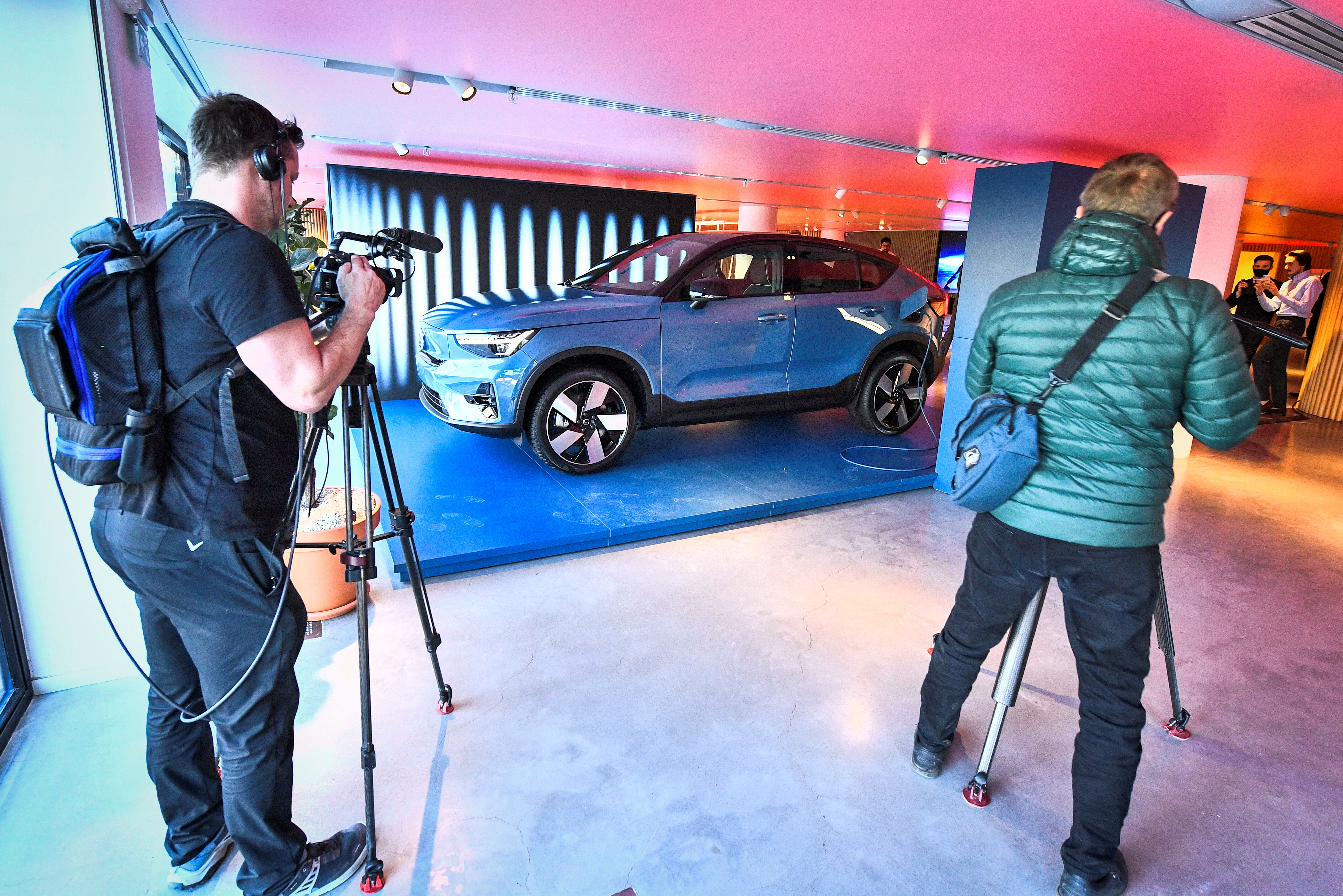 Members of the media stand as Volvo's new electric car Volvo C40 Recharge is presented in Stockholm, Sweden March 2, 2021. Claudio Breciani/TT News Agency/via REUTERS