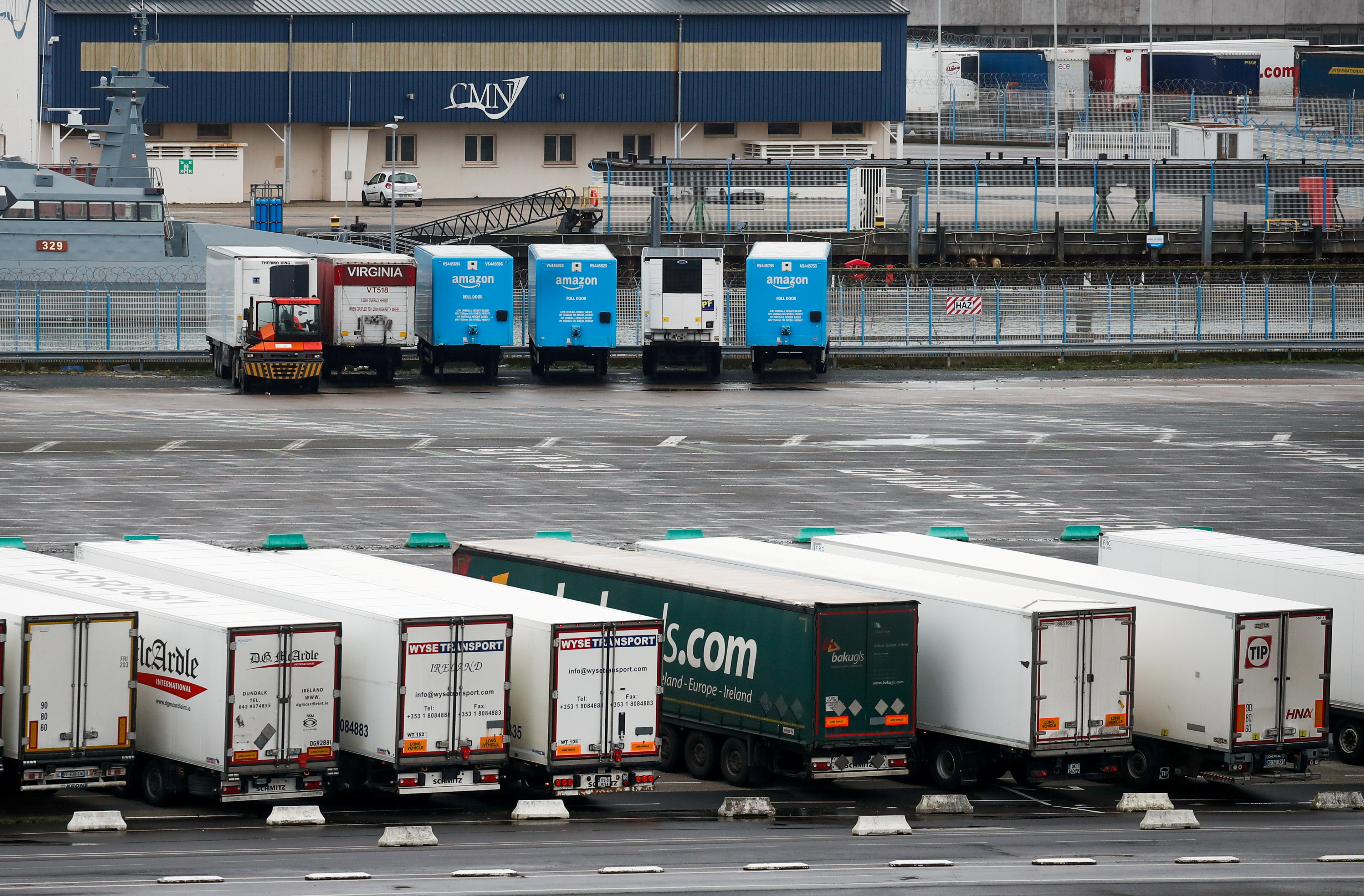 Amazon trailer trucks are seen at Cherbourg Harbour, France January 21, 2021. Brexit delays and customs checks have led to a surge in demand to ship goods in and out of Ireland direct to European ports like Cherbourg in France. REUTERS/Gonzalo Fuentes