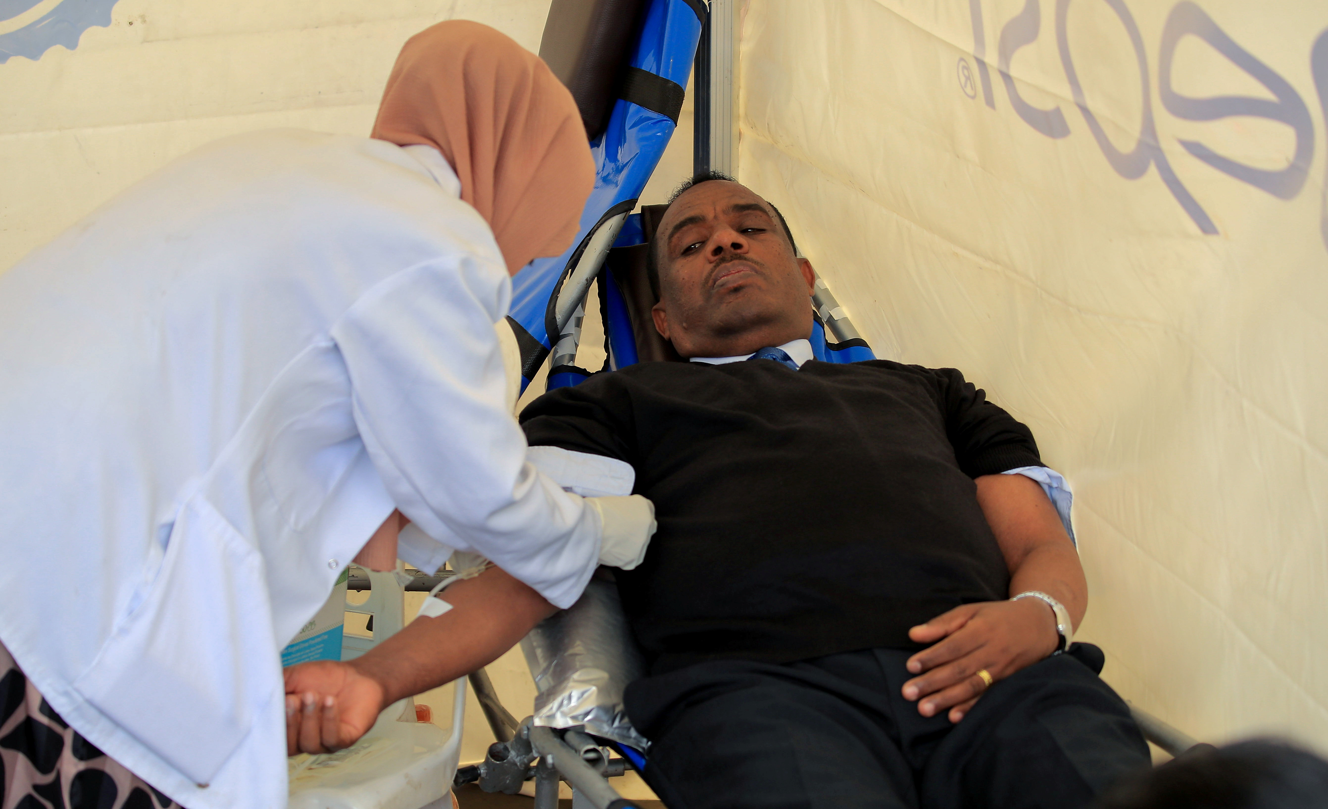 Kenea Yadeta, Defense Minister of Ethiopia, donates blood during the farewell ceremony for the Recruits to join Ethiopia's Defense Force at the Meskel Square in Addis Ababa, Ethiopia July 27, 2021. REUTERS/Tiksa Negeri