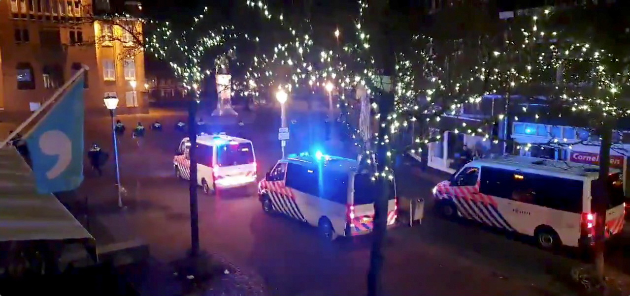 Police officers and vehicles arrive to disperse people from out from the site of one of the coronavirus disease (COVID-19) curfew protests in Geleen, Netherlands January 25, 2021, in this still image from video obtained from social media. Evert Bopp via REUTERS