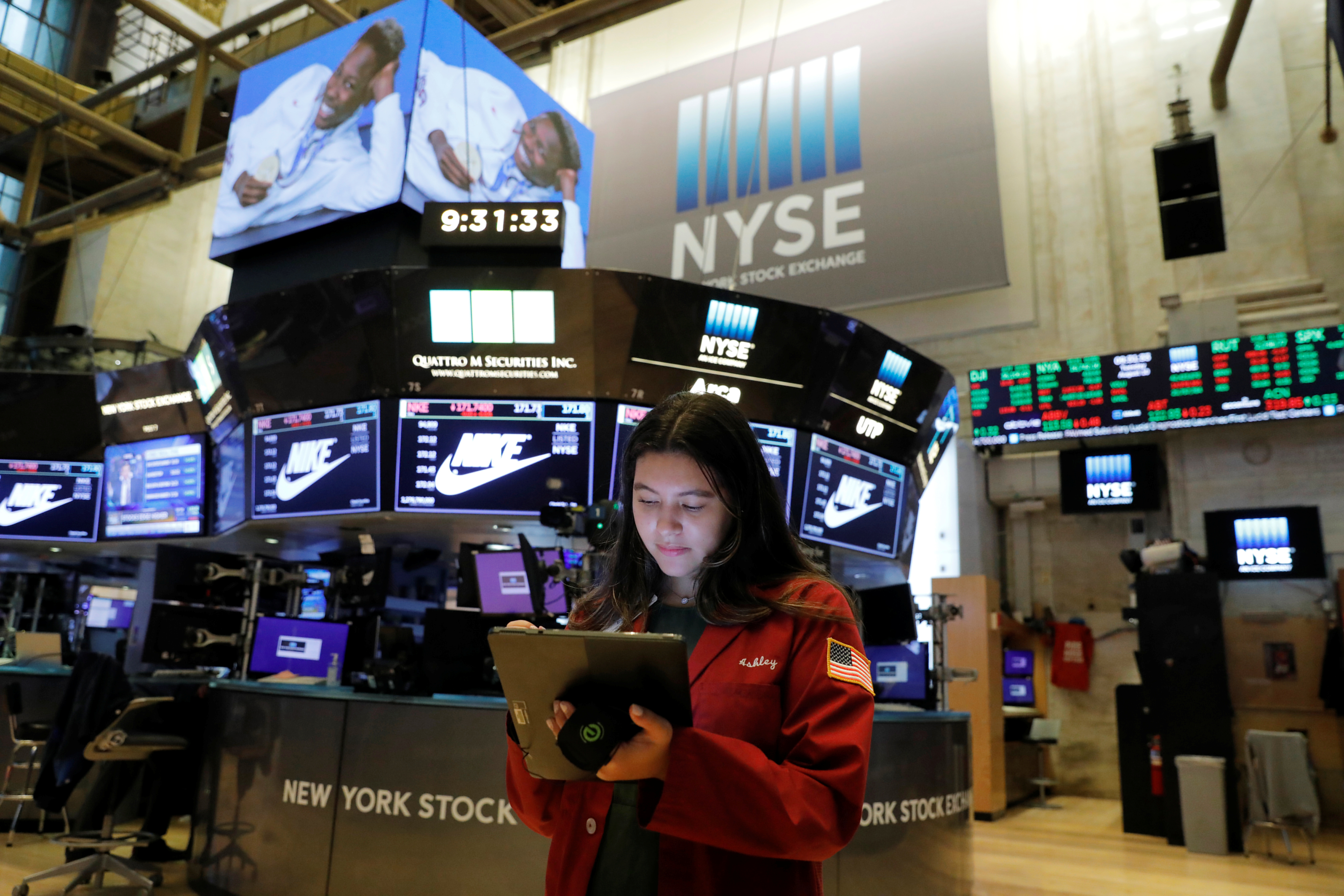 A trader works on the trading floor at the New York Stock Exchange (NYSE) in Manhattan, New York City, U.S., August 10, 2021. REUTERS/Andrew Kelly