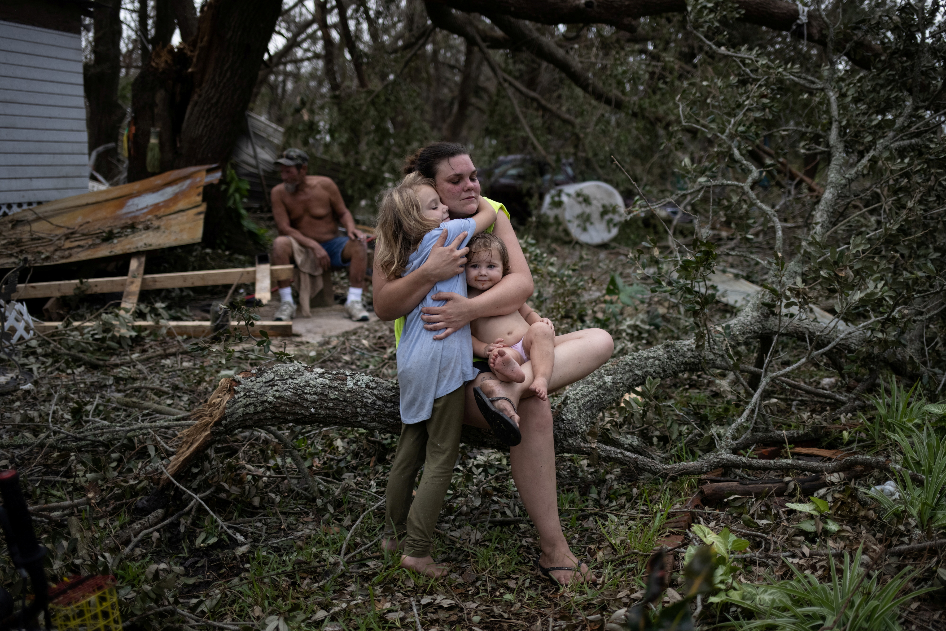 Tiffany Miller is embraced by her daughter Desilynn, 6, as she holds her one year old godchild Charleigh, after the family returned to their destroyed home in the aftermath of Hurricane Ida in Golden Meadow, Louisiana, U.S., September 1, 2021. REUTERS/Adrees Latif