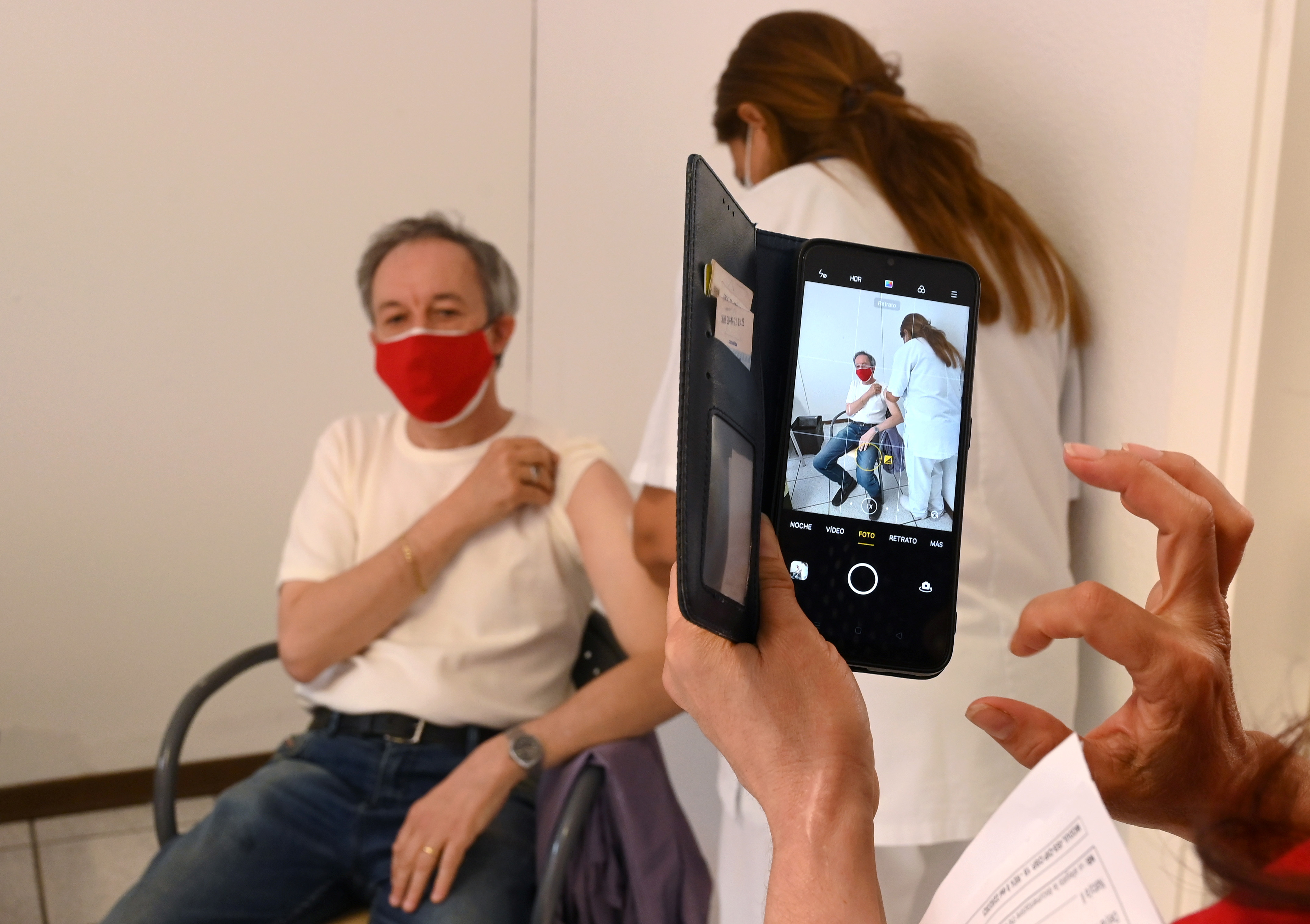 Italian citizen Silvano Cecconi, receives a dose of Russia's Sputnik V COVID-19 vaccine, as the Republic of San Marino starts a campaign inviting tourists to get vaccinated, June 1, 2021. Picture taken June 1, 2021. REUTERS/Alberto Lingria