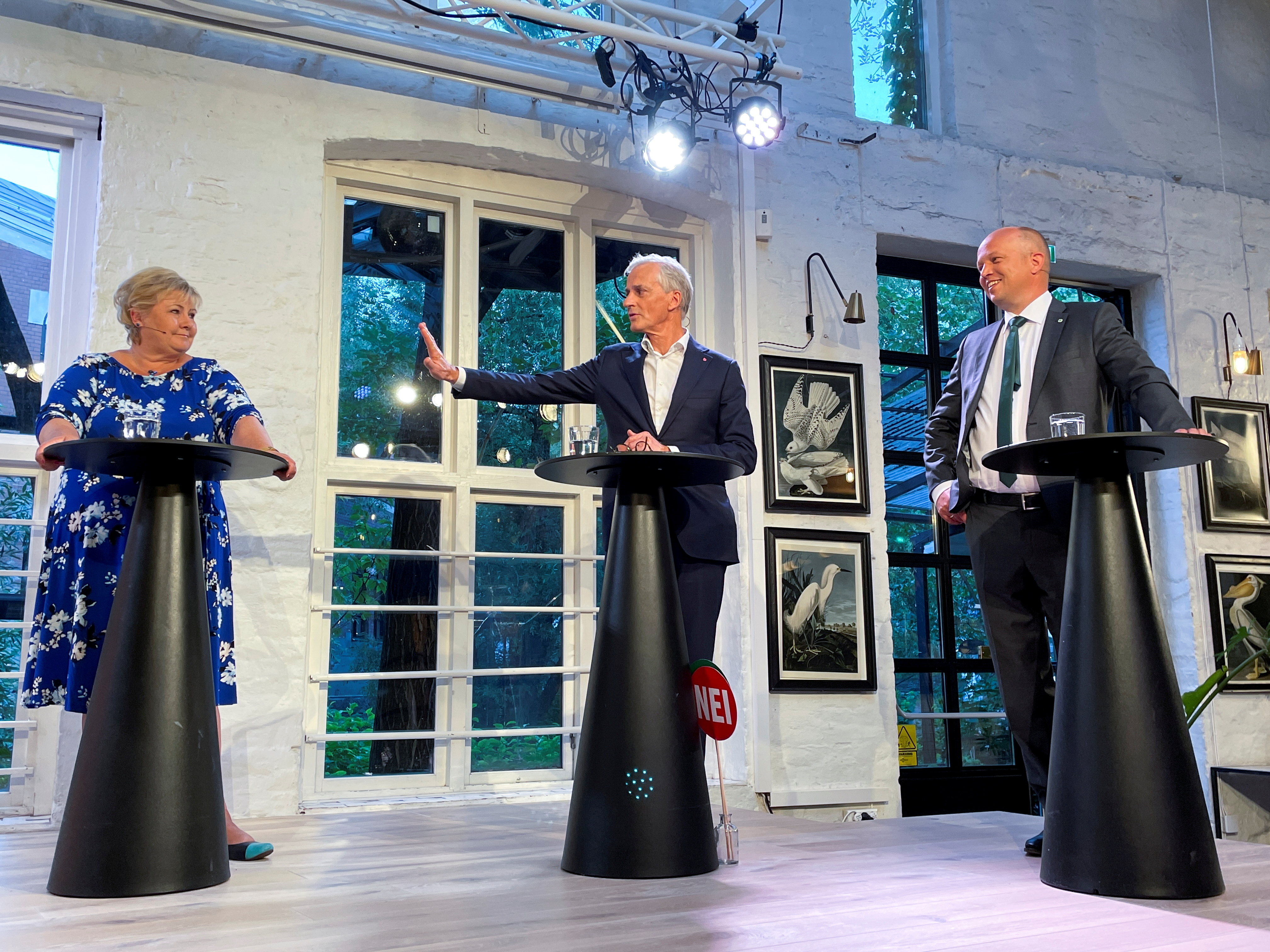 The three candidates for Norway's prime minister Erna Solberg from the Conservatives, Jonas Gahr Stoere from Labour Party and Trygve Slagsvold Vedum from the Centre Party attend a debate in central Oslo, Norway August 9, 2021. REUTERS/Gwladys Fouche/File Photo
