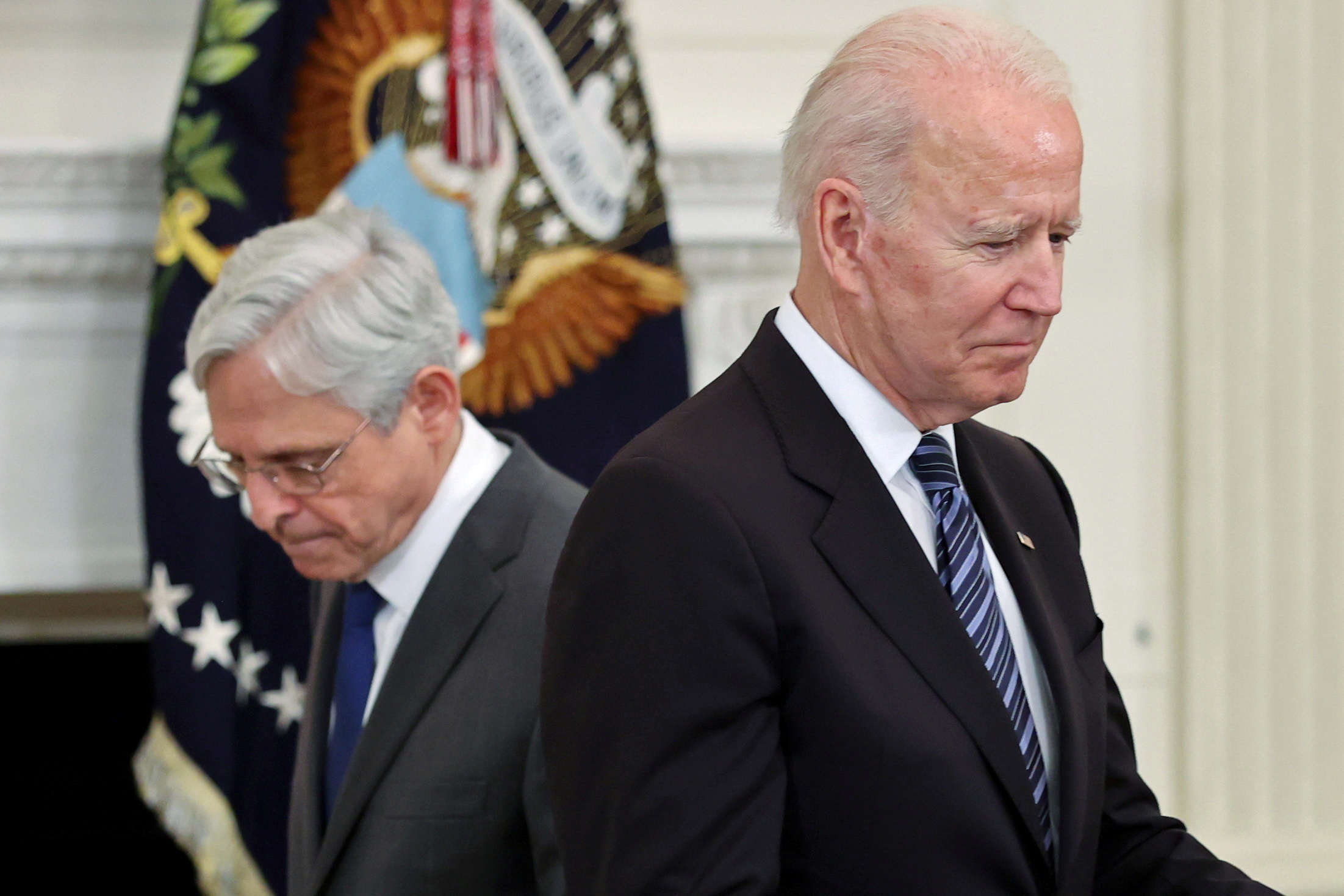 U.S. Attorney General Merrick Garland is seen next to U.S. President Joe Biden during the delivery of remarks after a roundtable discussion with advisors on steps to curtail U.S. gun violence, at the White House in Washington, U.S. June 23, 2021. REUTERS/Jonathan Ernst
