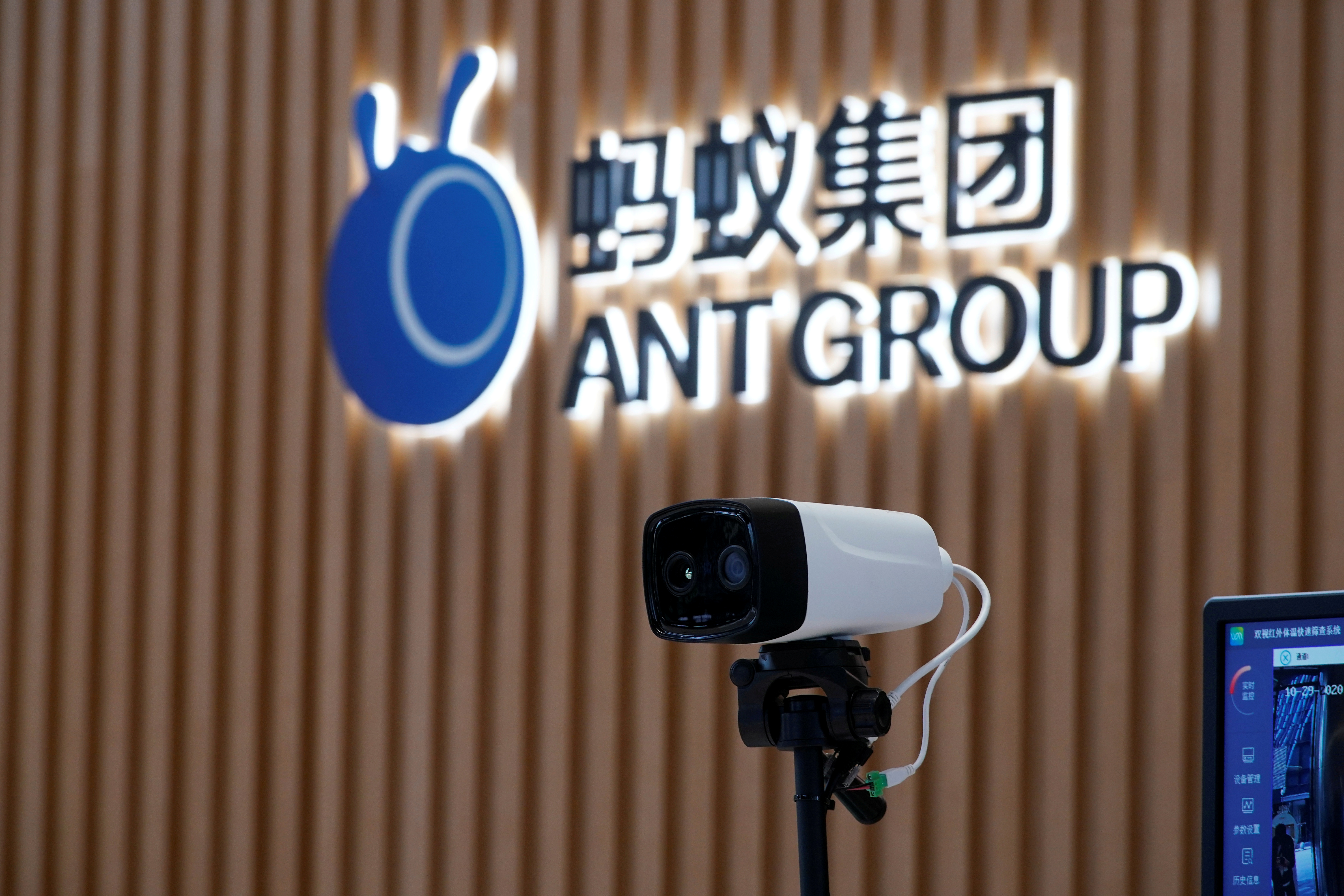 A thermal imaging camera is seen in front of a logo of Ant Group at the headquarters of Ant Group, an affiliate of Alibaba, in Hangzhou, Zhejiang province, China October 29, 2020.  REUTERS/Aly Song