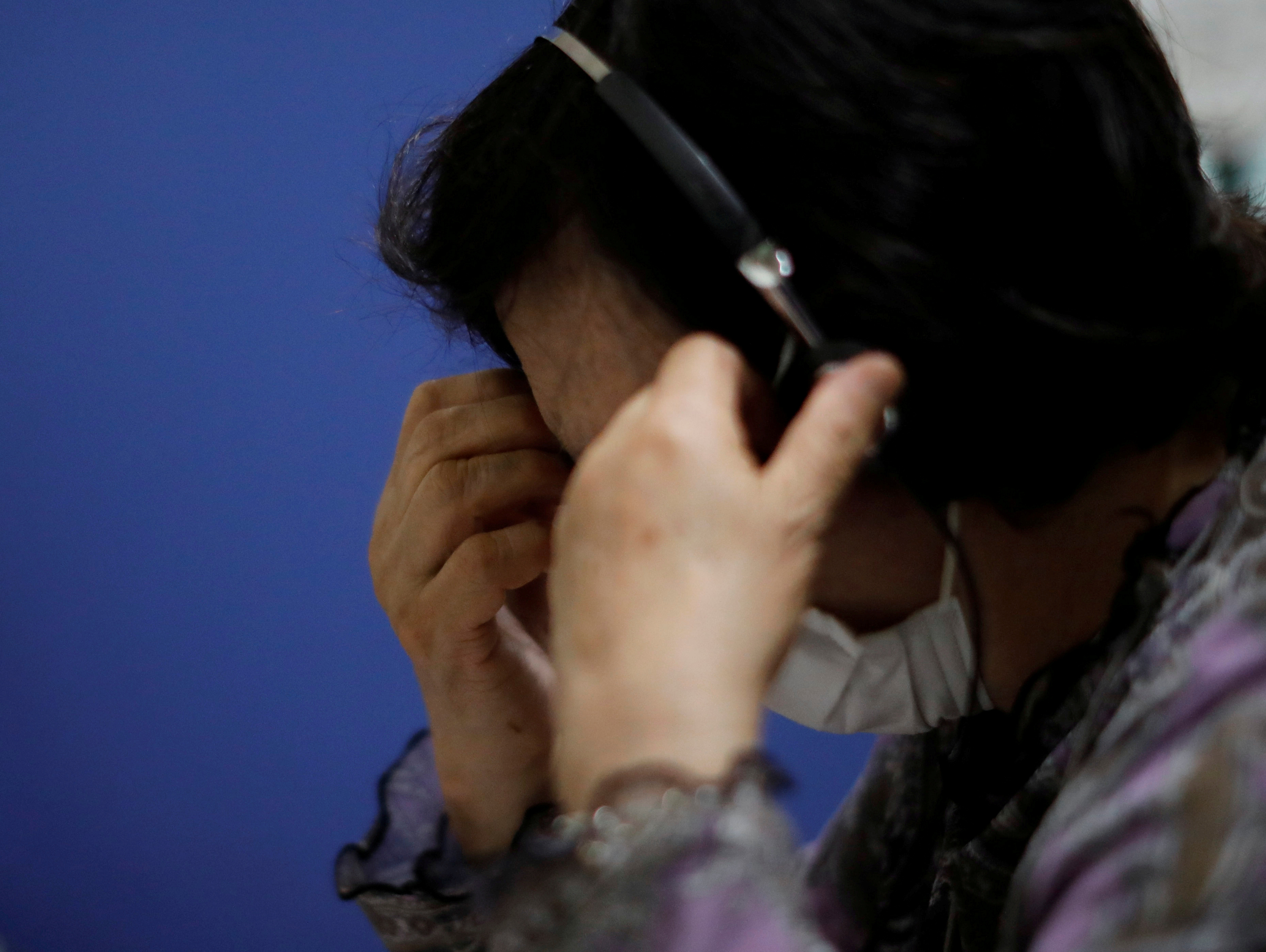 A volunteer responds an incoming call at the Tokyo Befrienders call center, a Tokyo's suicide hotline center, during the spread of the coronavirus disease (COVID-19), in Tokyo, Japan May 26, 2020. REUTERS/Issei Kato
