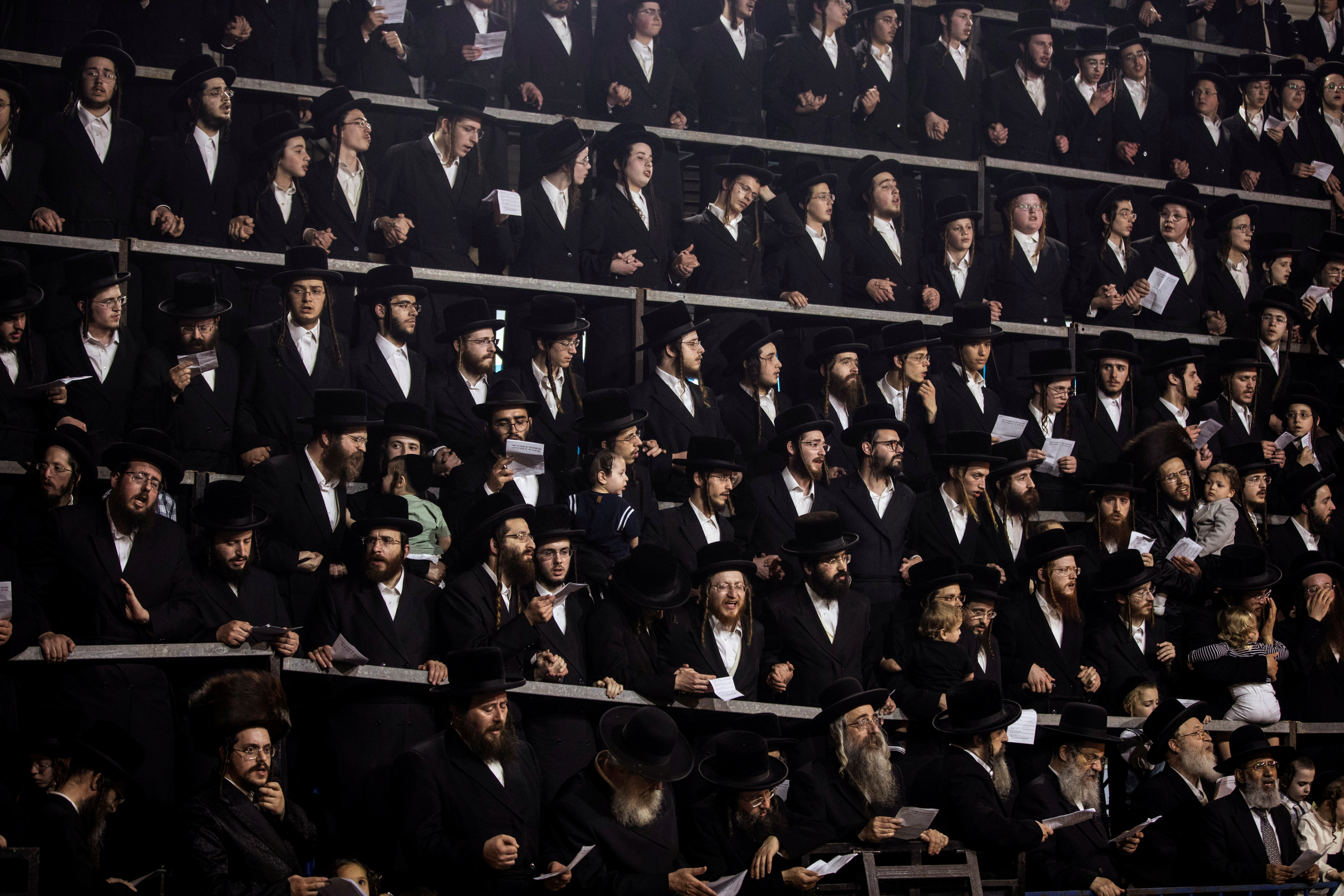 Ultra-Orthodox Jews sing and dance as they stand on tribunes at the Lag B'Omer event in Bnei Brak, near Tel Aviv, Israel April 29, 2021. REUTERS/Nir Elias/File Photo